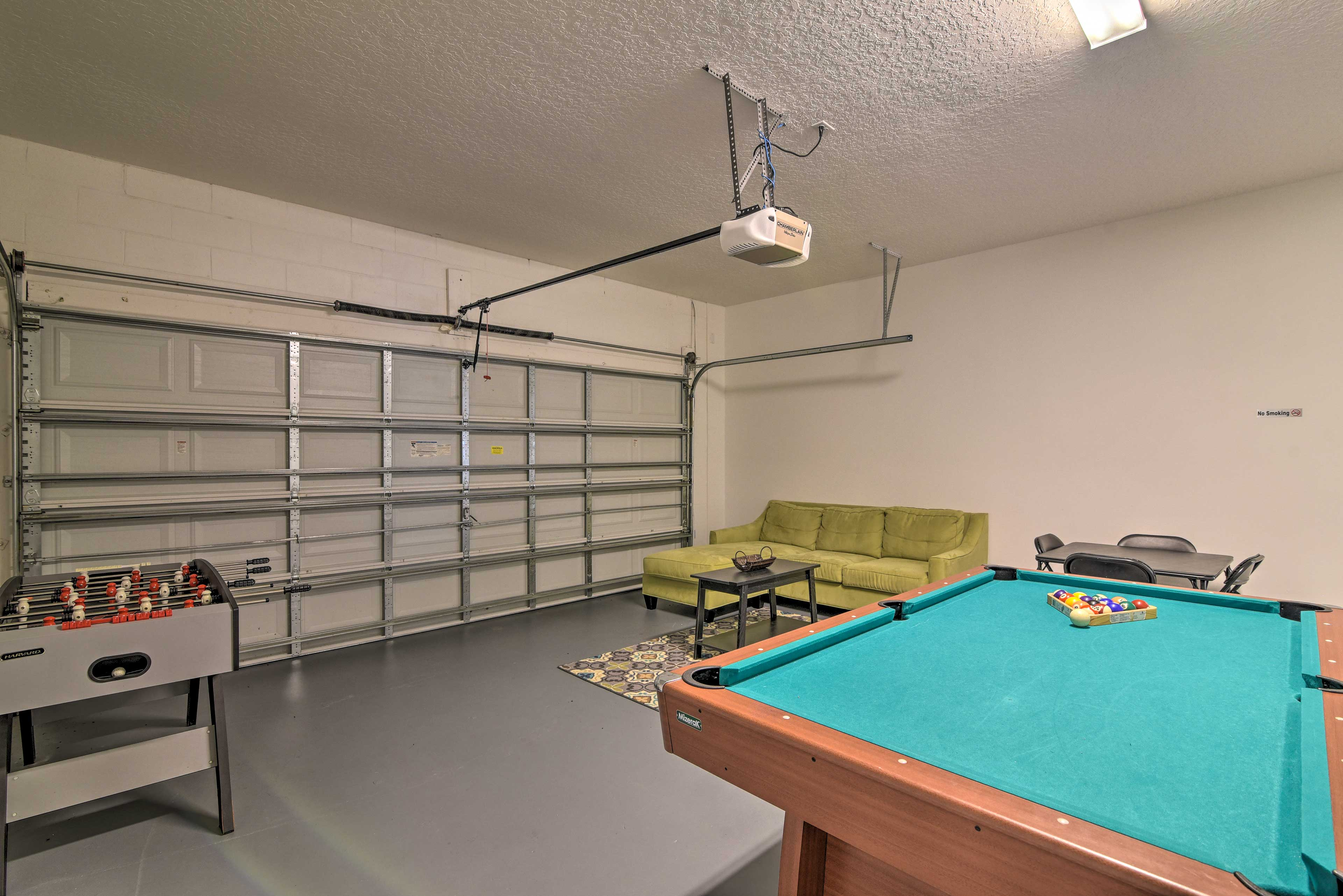 There is a pool table and foosball table in this room.