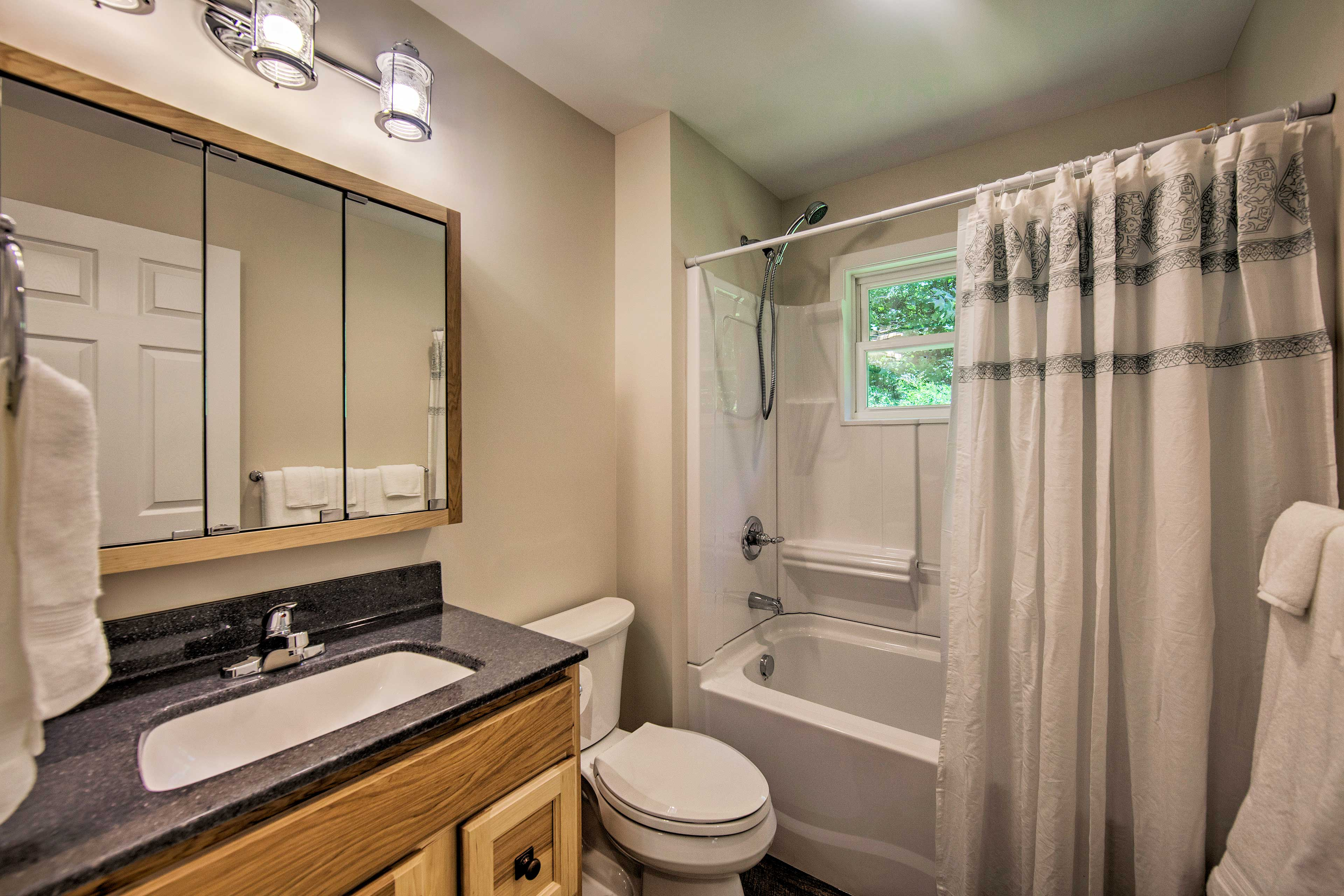 The second bathroom is equipped with a shower/tub combo.