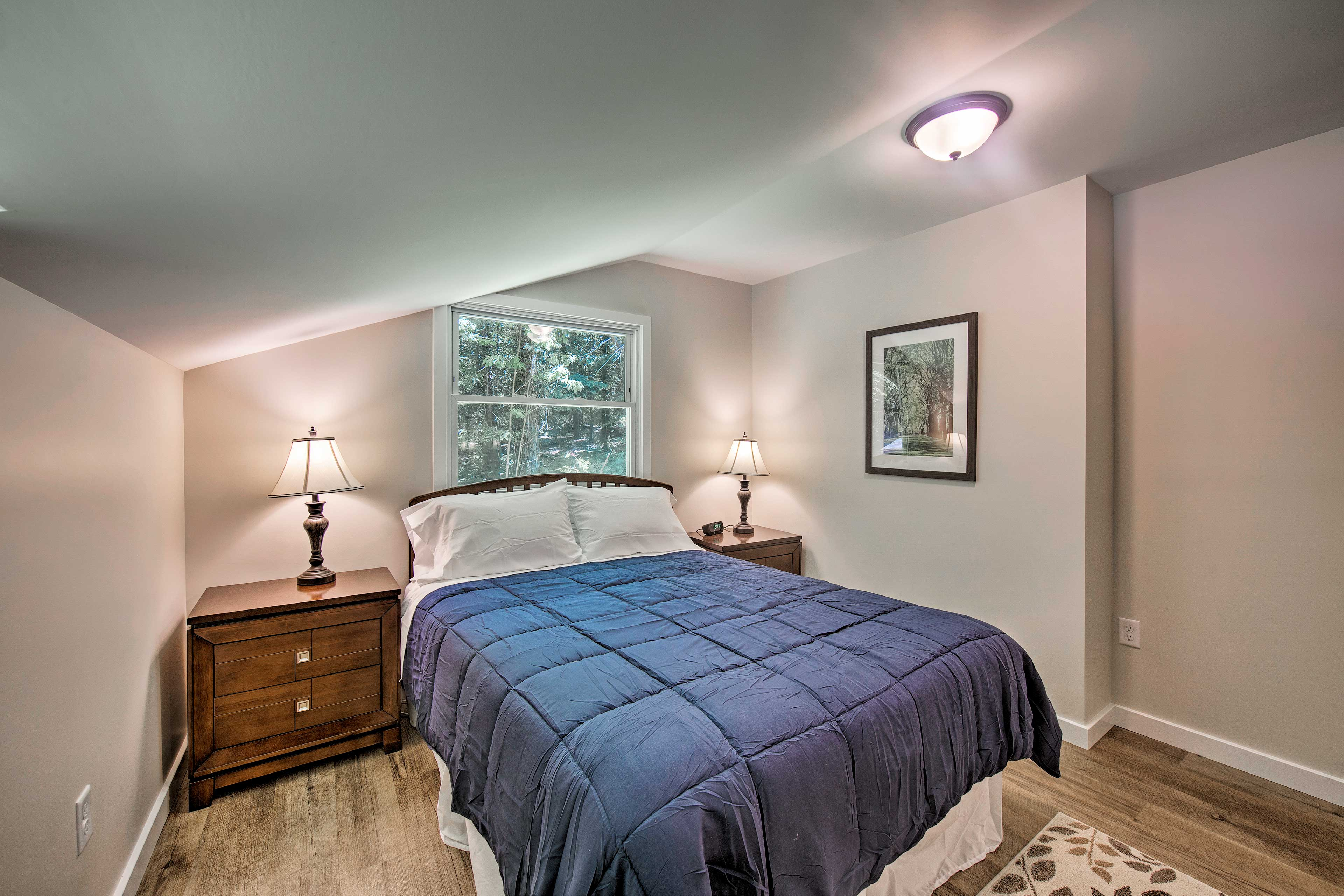 This room is outfitted with a queen bed as well.