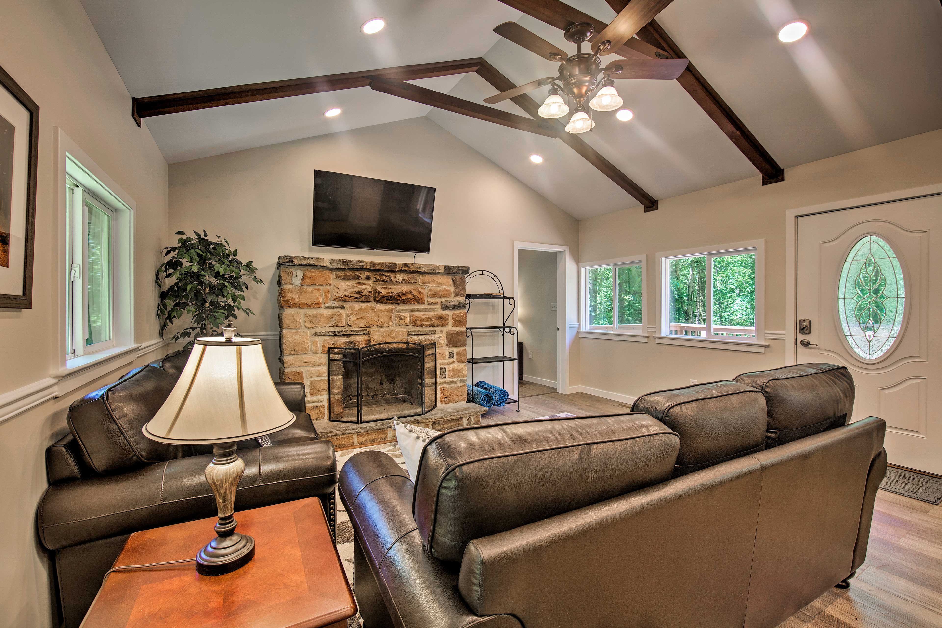 The living room boasts a wood-burning fireplace and flat-screen TV.