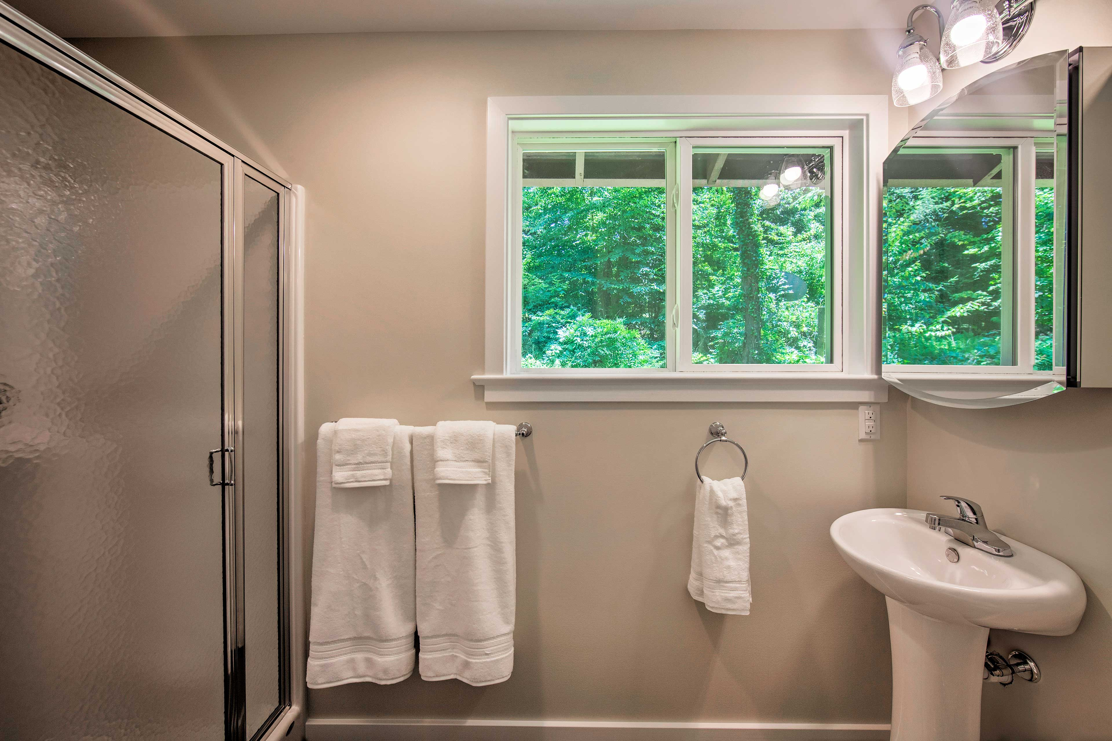 Rinse off in this shower/tub combo.