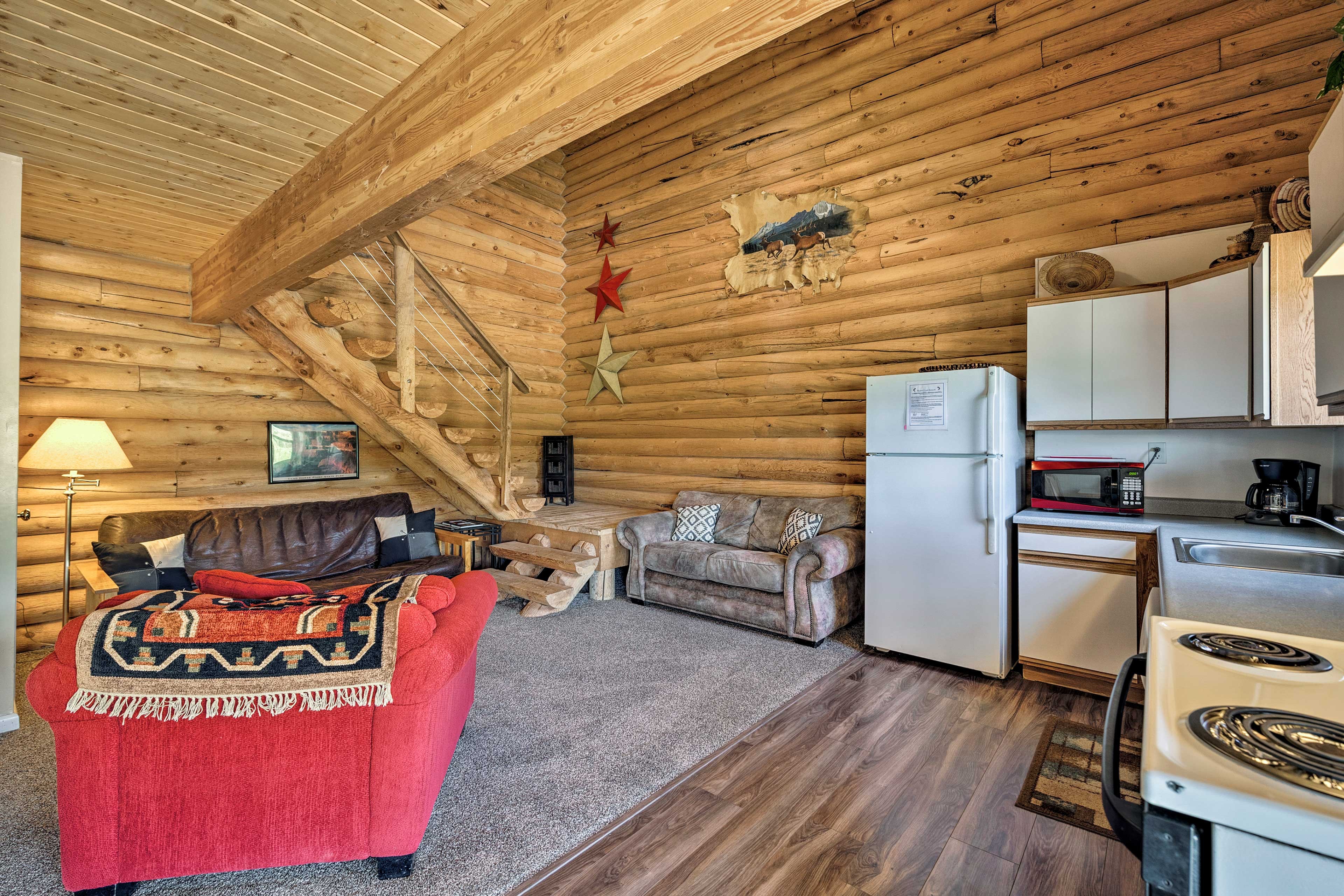 Rustic decor highlights this authentic log cabin.