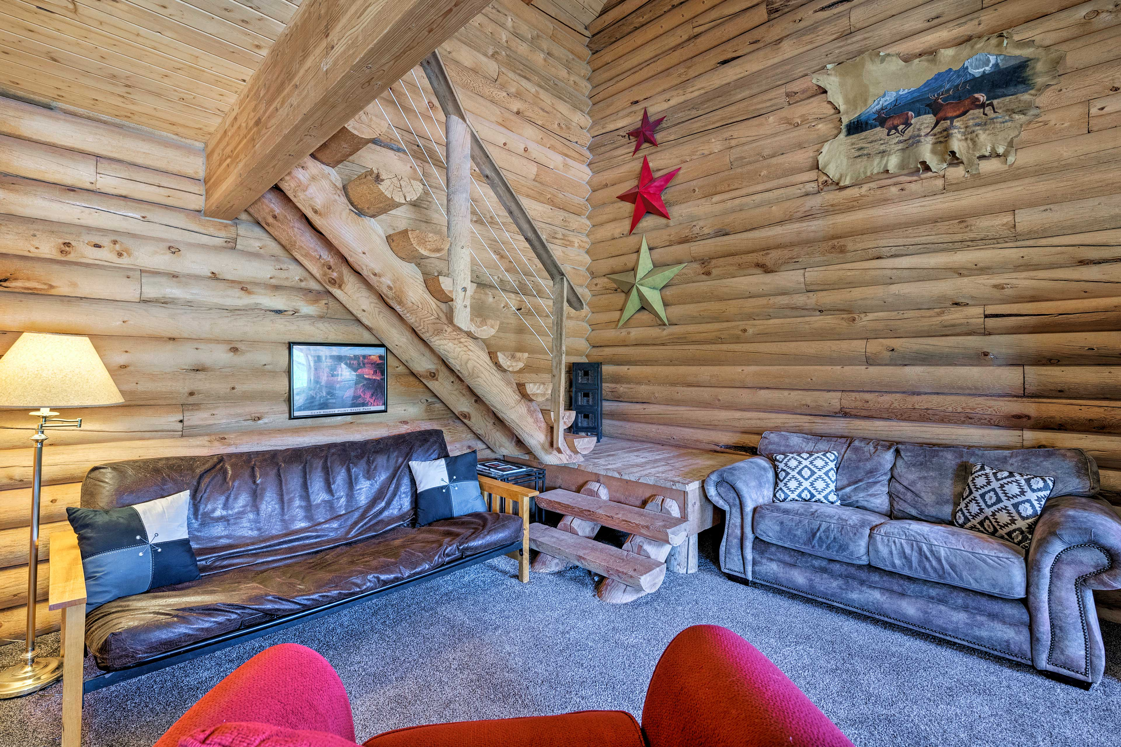The 1,000-square-foot interior features 2 bedrooms, 1 bath and room for 6.