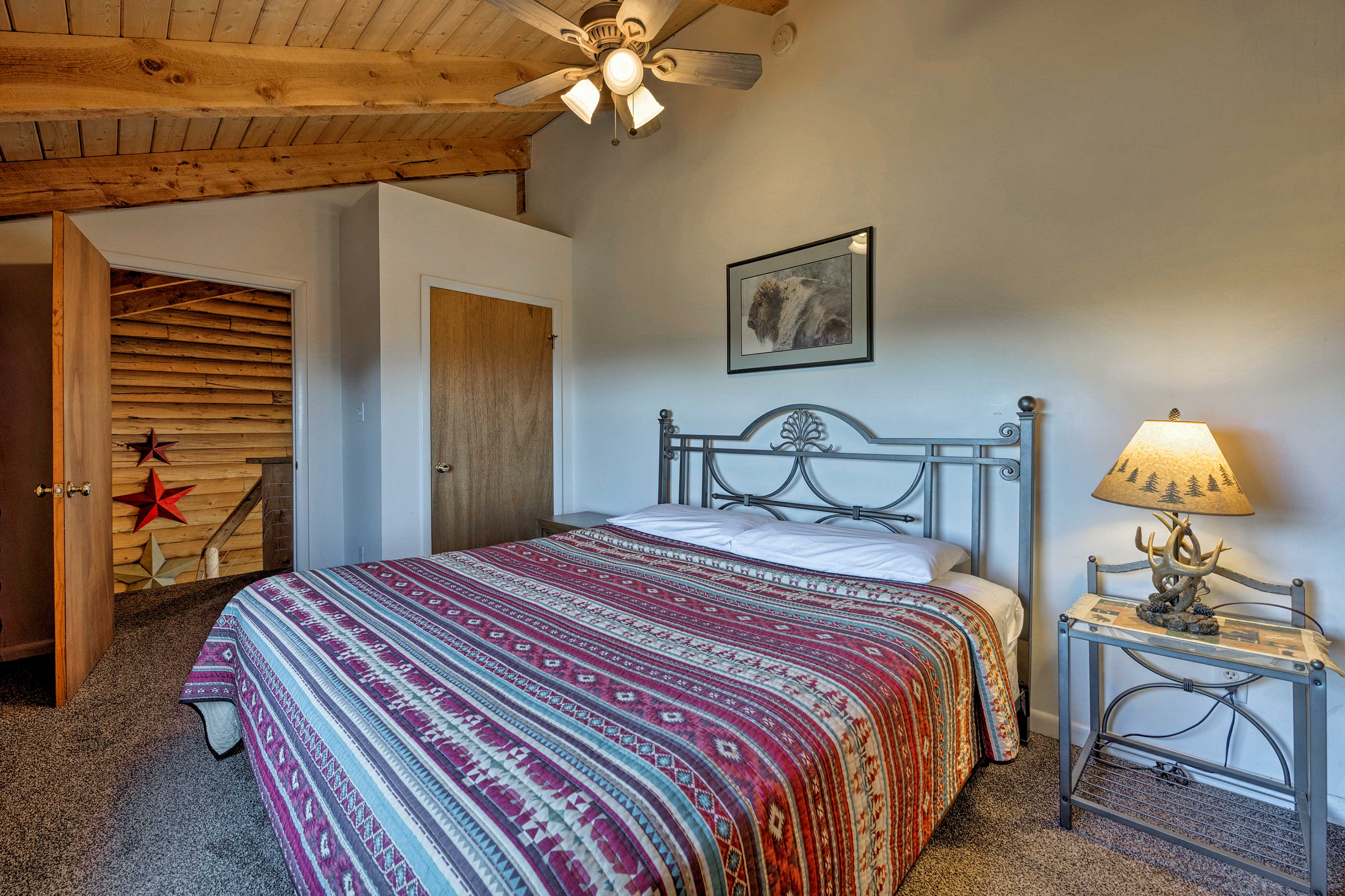 A king bed highlights this master bedroom.