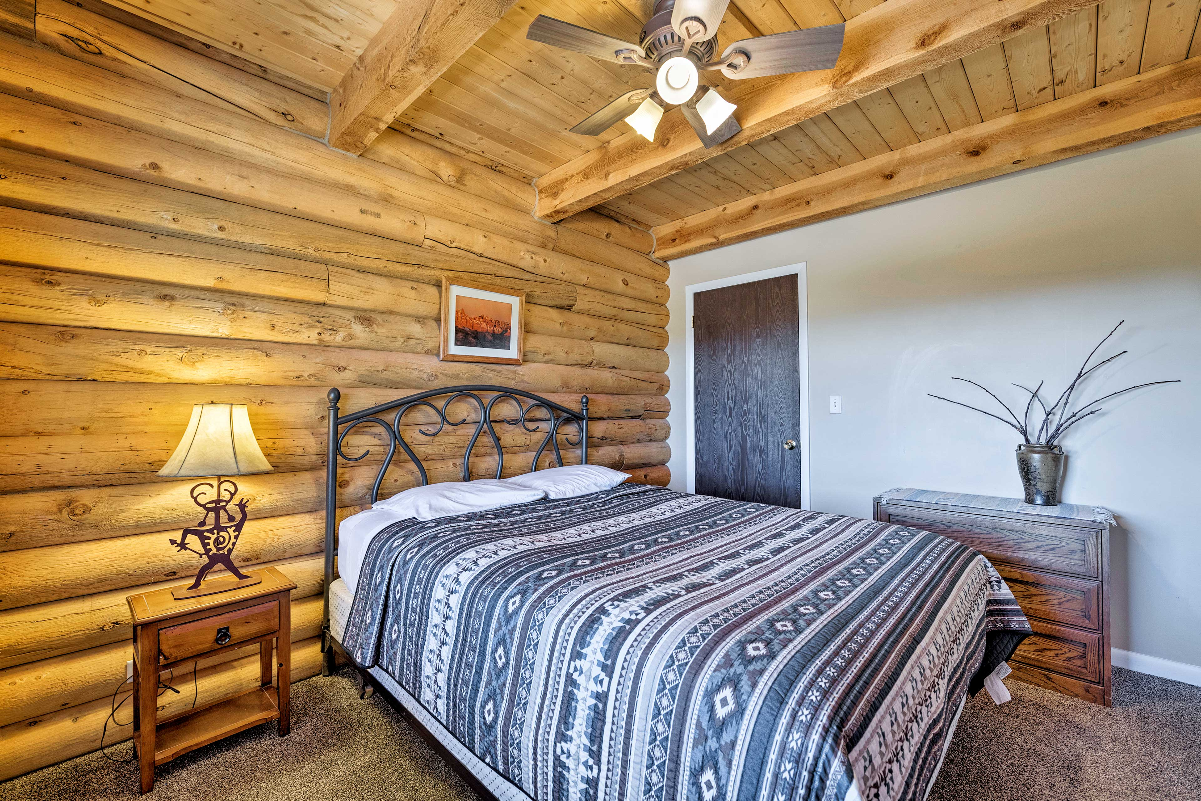 Couples will sleep easy on this bedroom's queen bed.