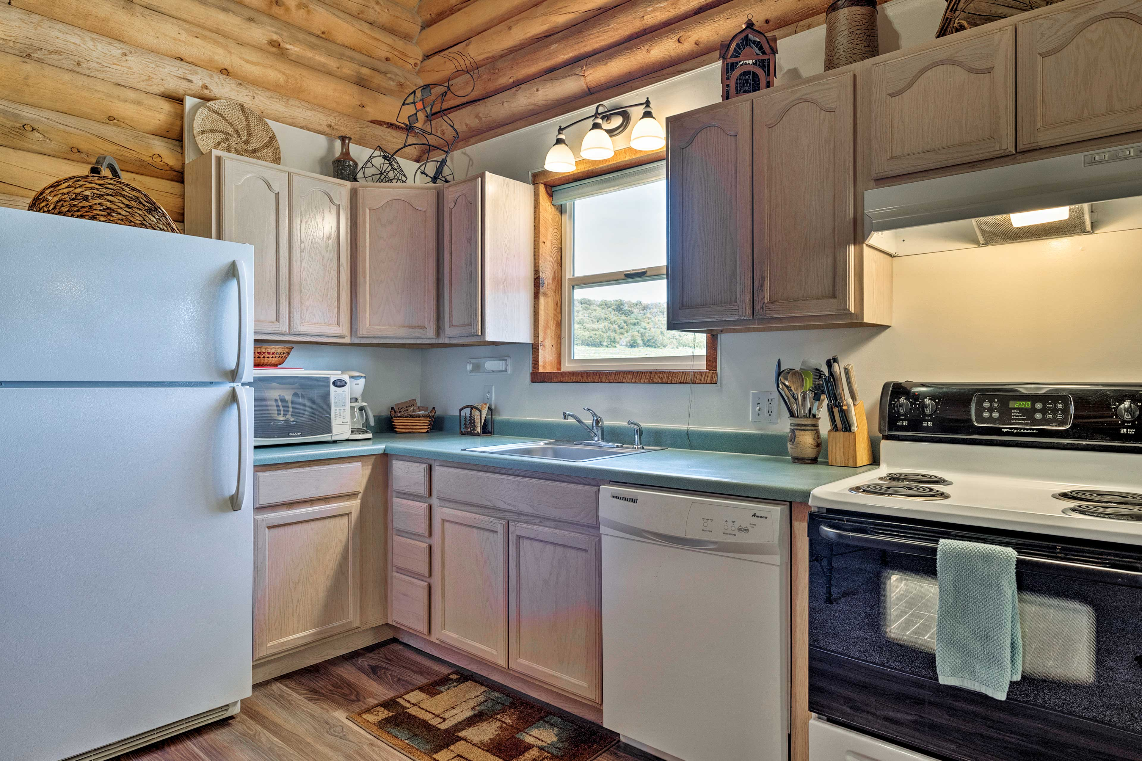You'll find every necessary pot & pan in this fully equipped kitchen.