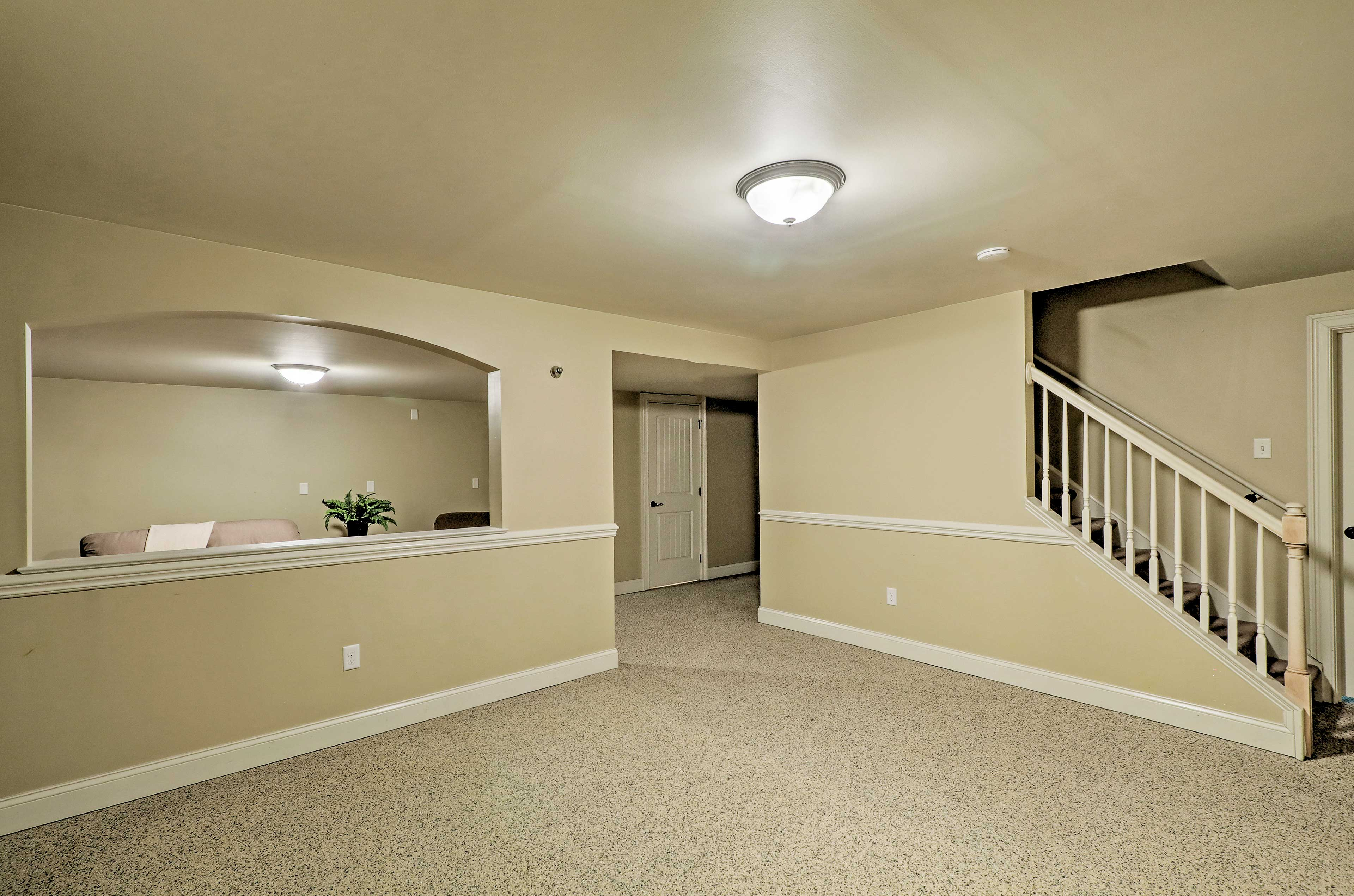 Downstairs, you'll find another living area and bedroom.