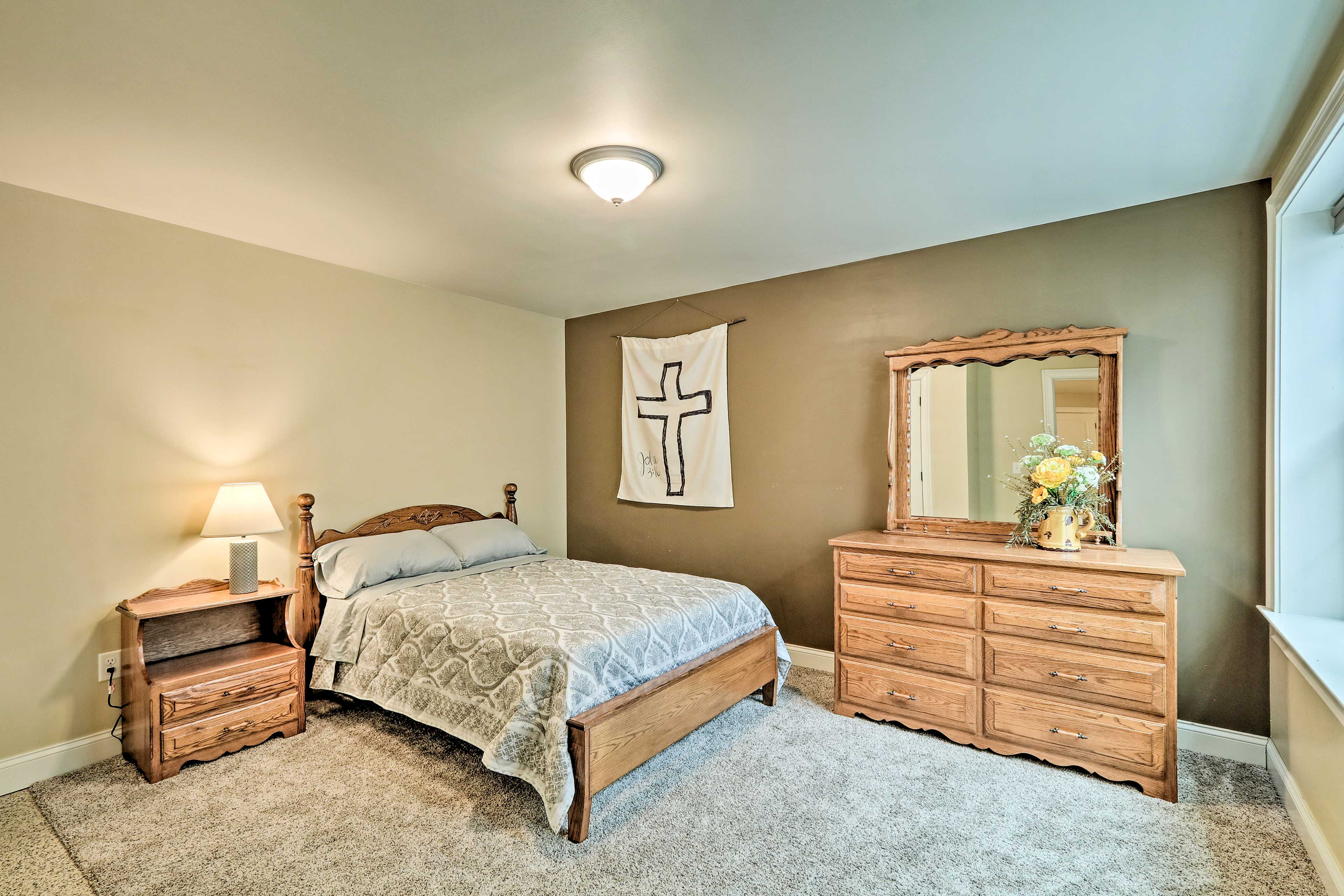 The 4th bedroom also features a full-sized bed and storage space.