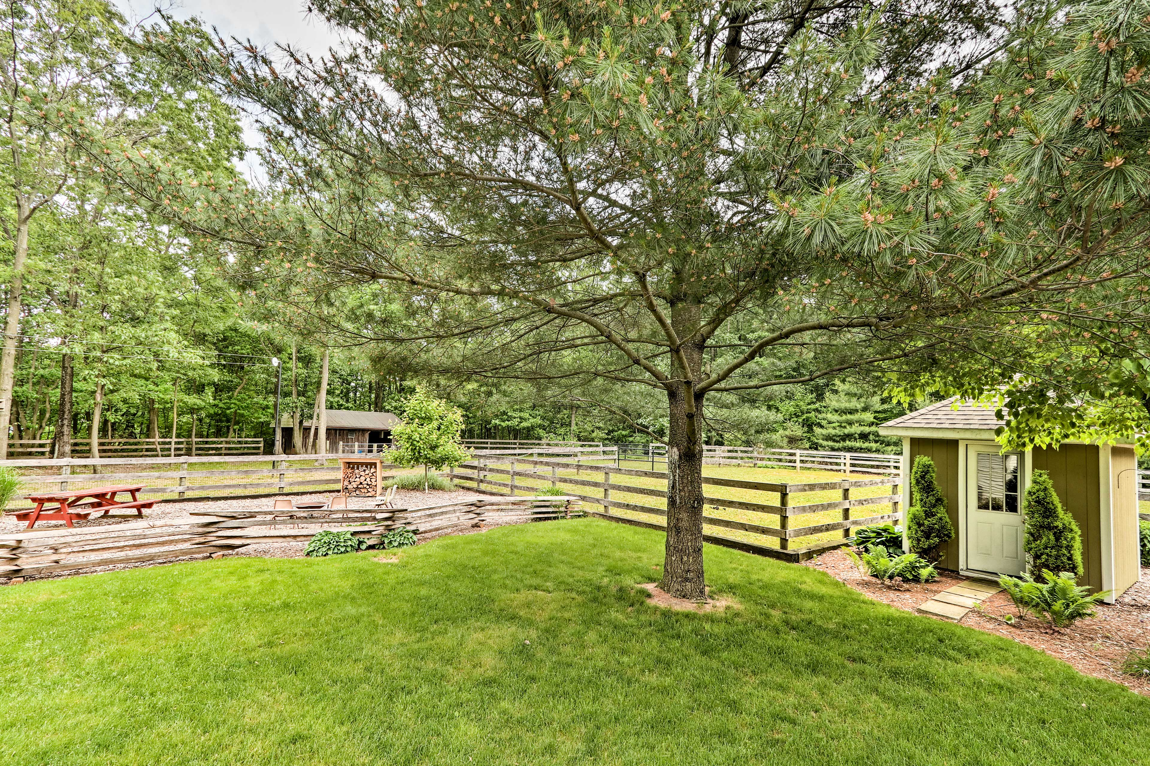 The home features a fire pit and picnic area.