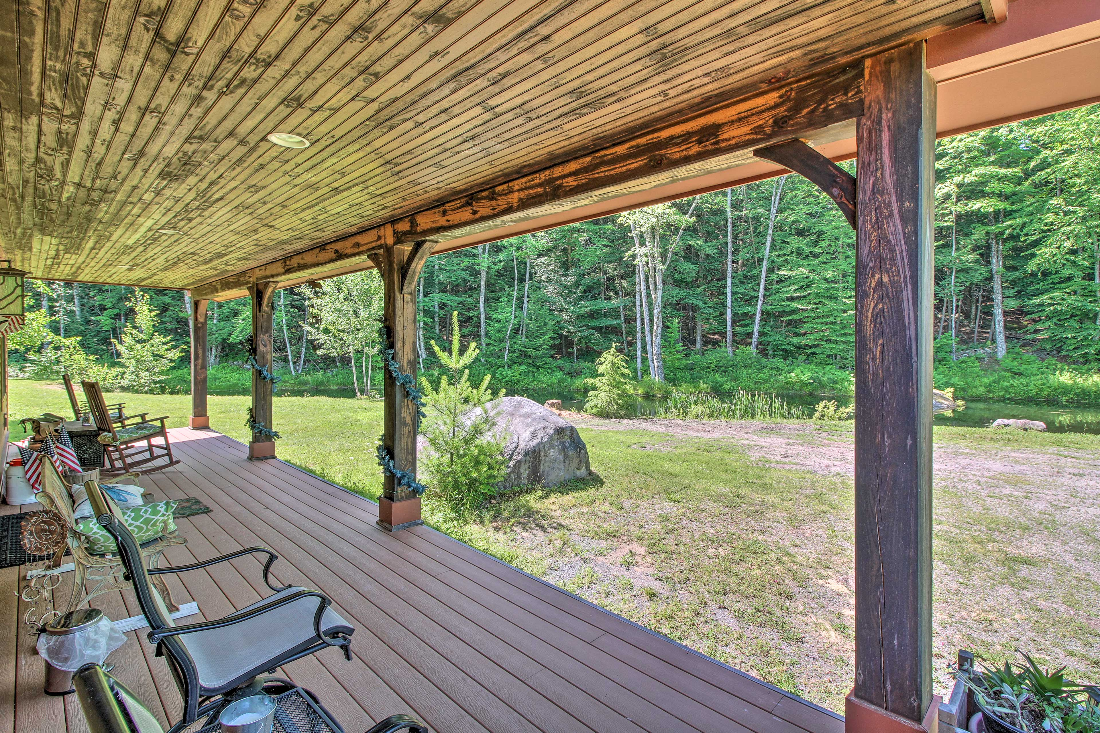 Enjoy pond views from the covered deck.