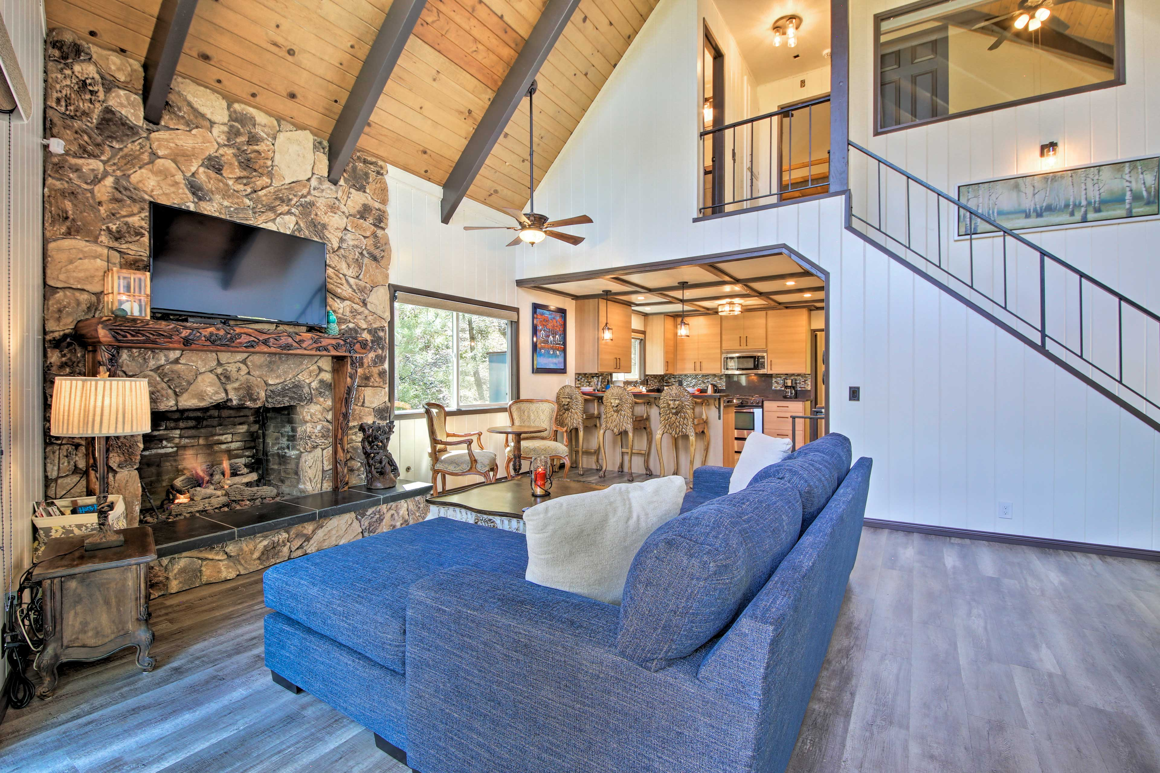 Warm your toes by the fire while admiring the home's rustic-yet-modern charm.