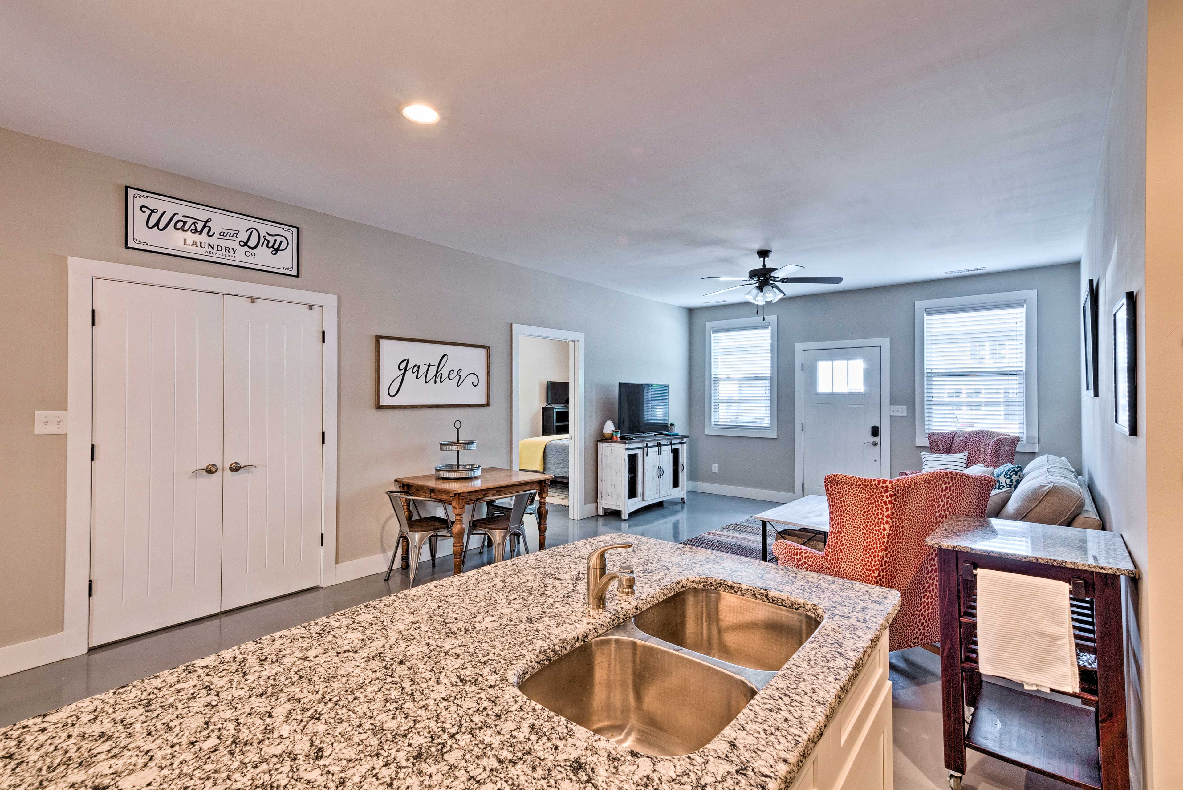 The kitchen is complete with granite counter tops & stainless steel appliances.