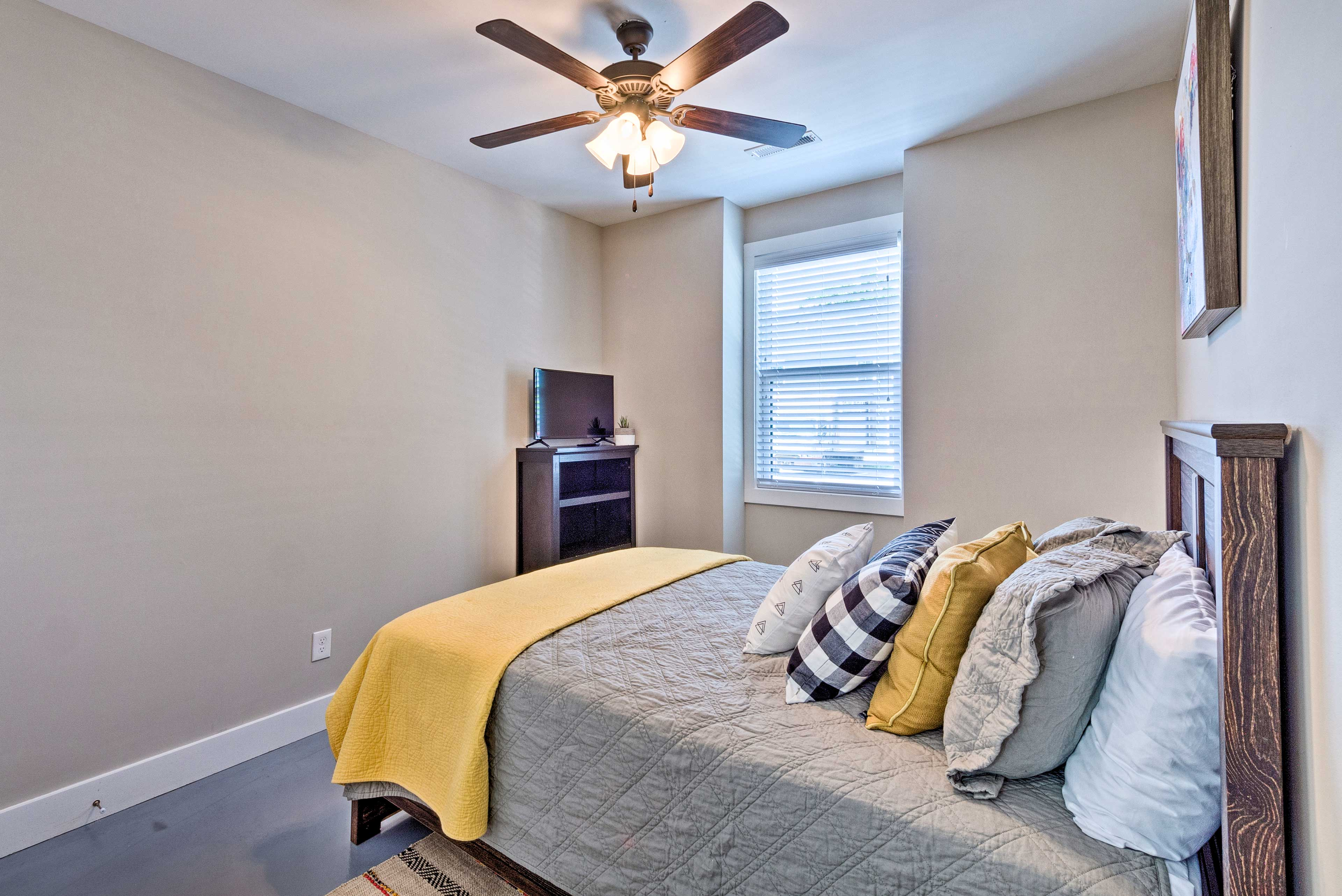 Enjoy a peaceful slumber in this queen bed.