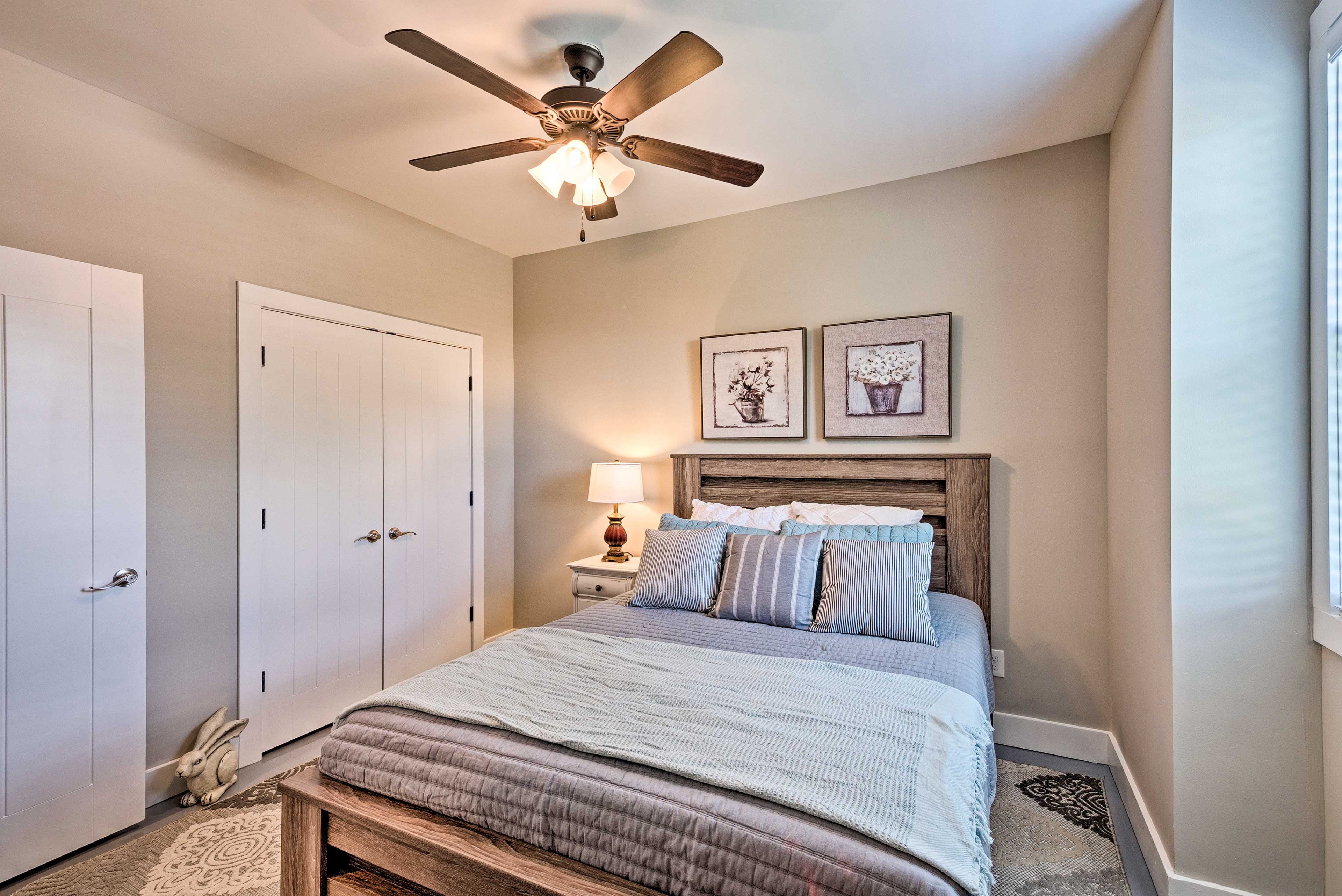 Rustic decor, a ceiling fan, and a closet complete this room.