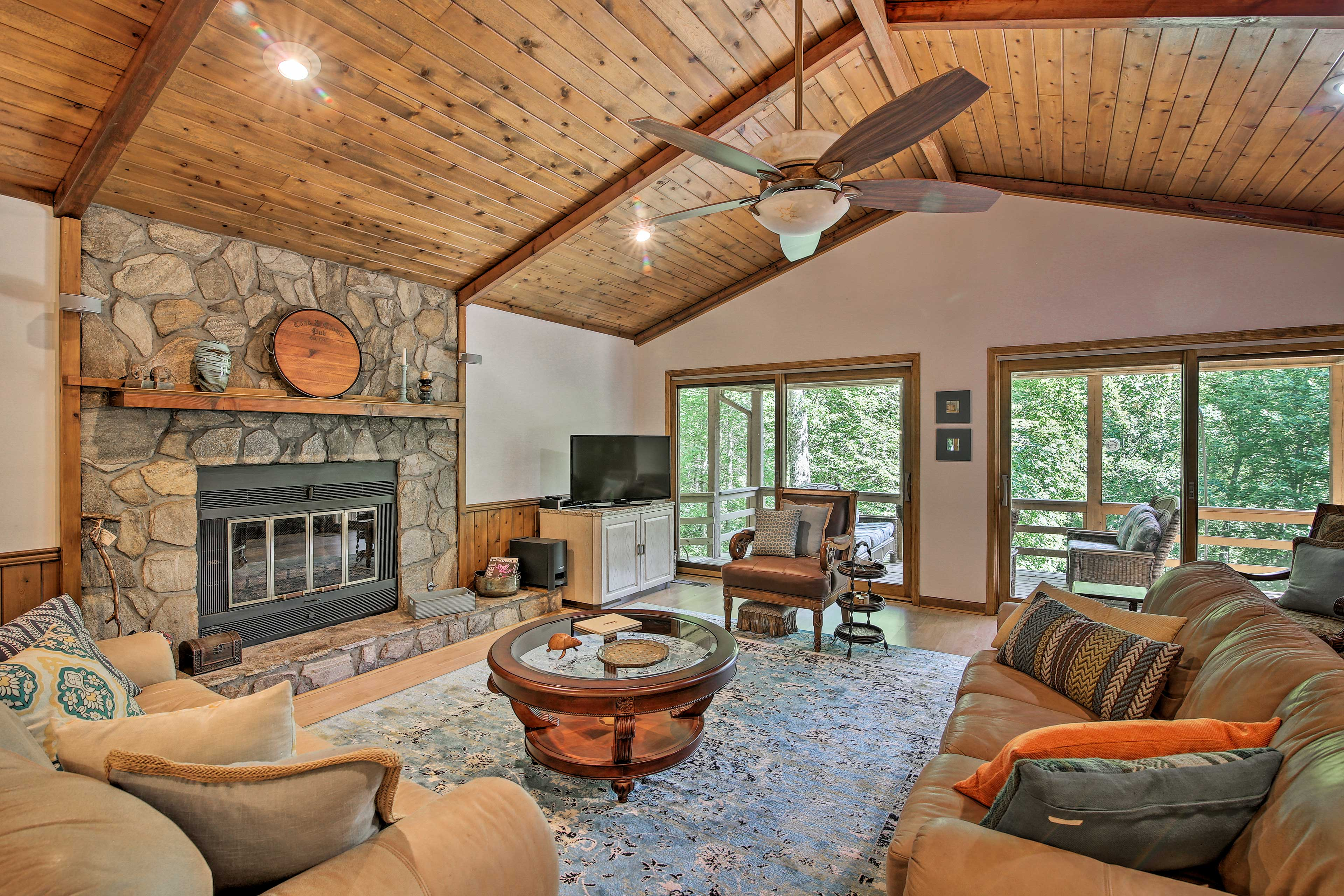 Vaulted ceilings, stunning views, and a stone fireplace highlight the great room
