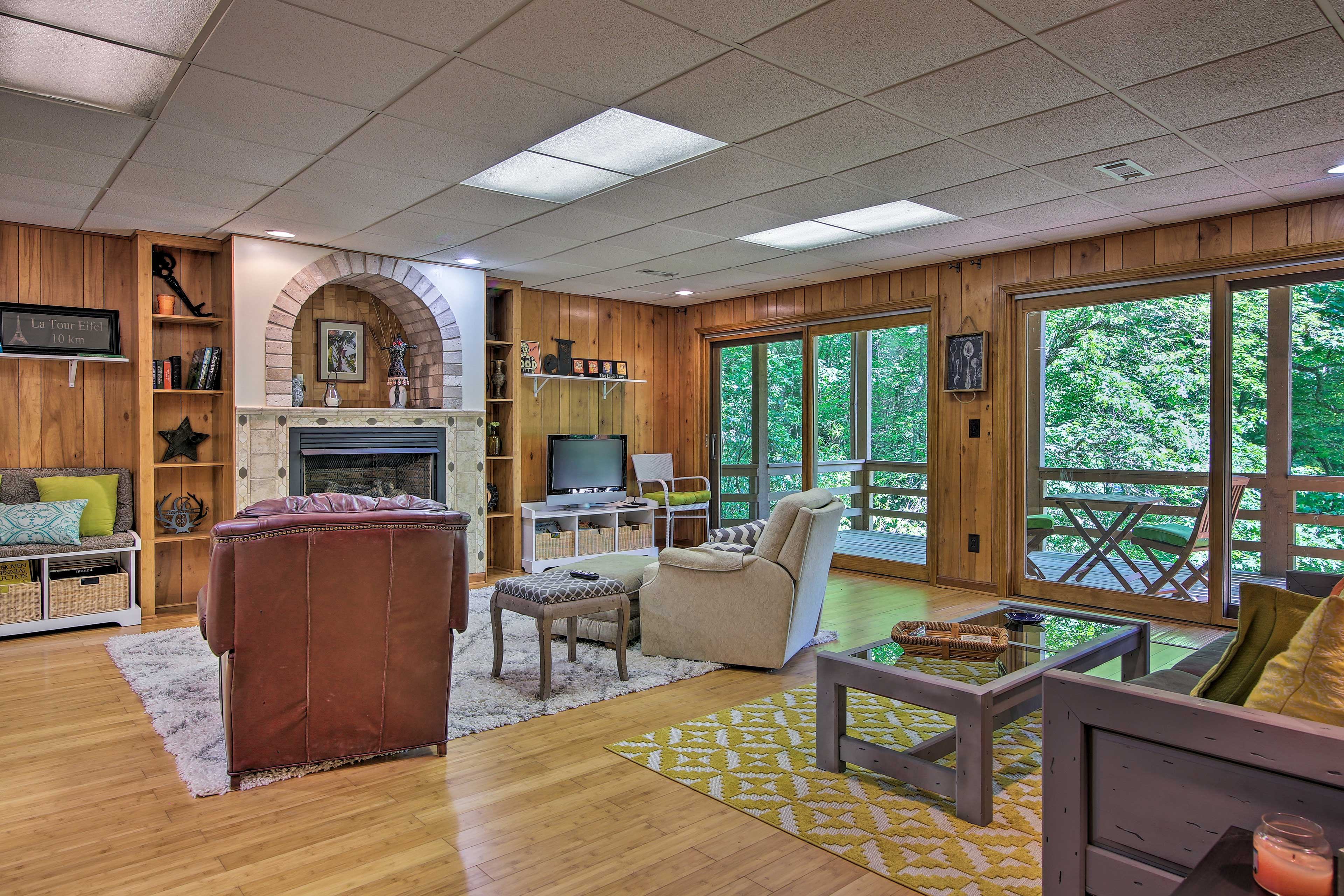 This bonus room features another fireplace, TV, and deck access.