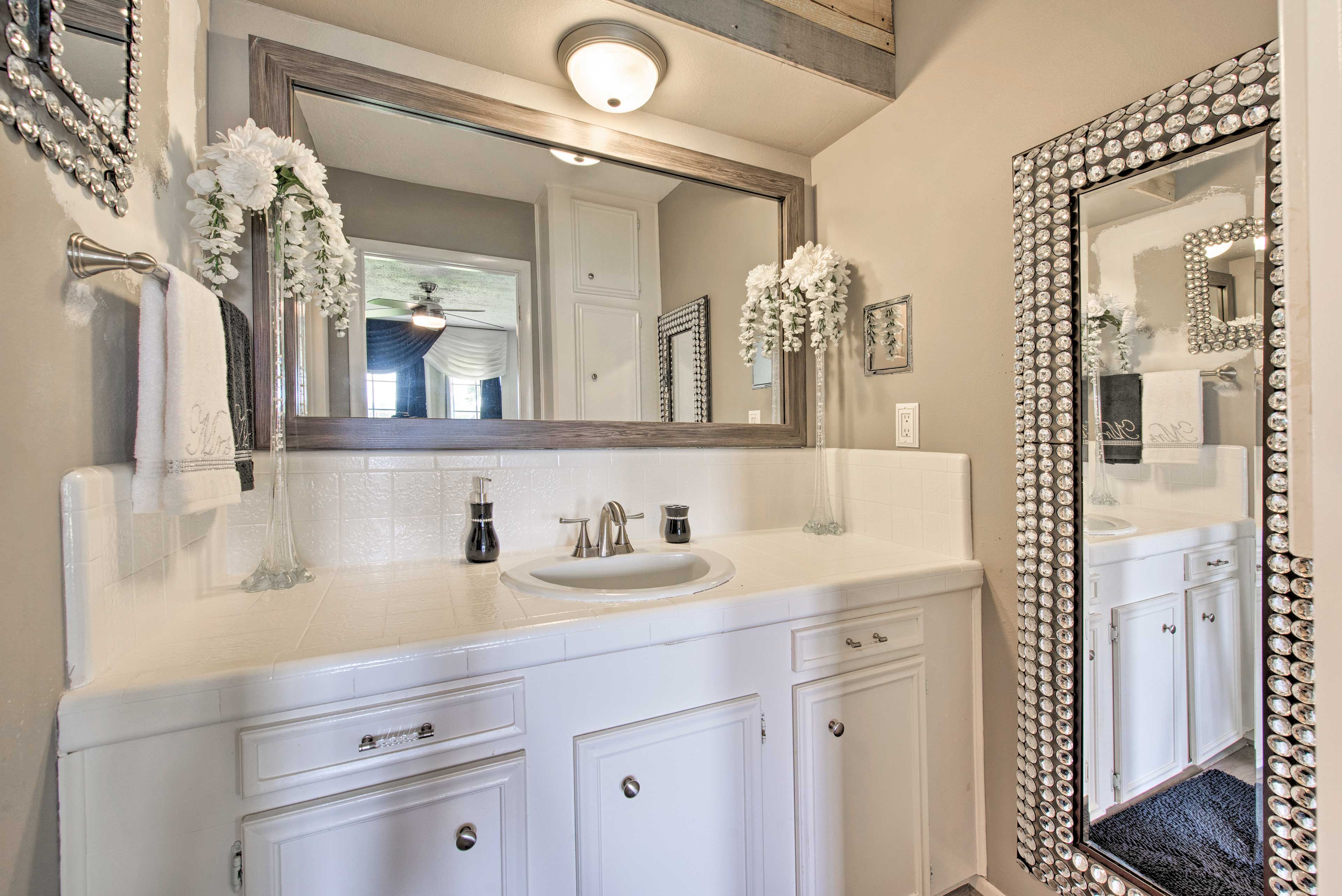 Freshen up in this bathroom.