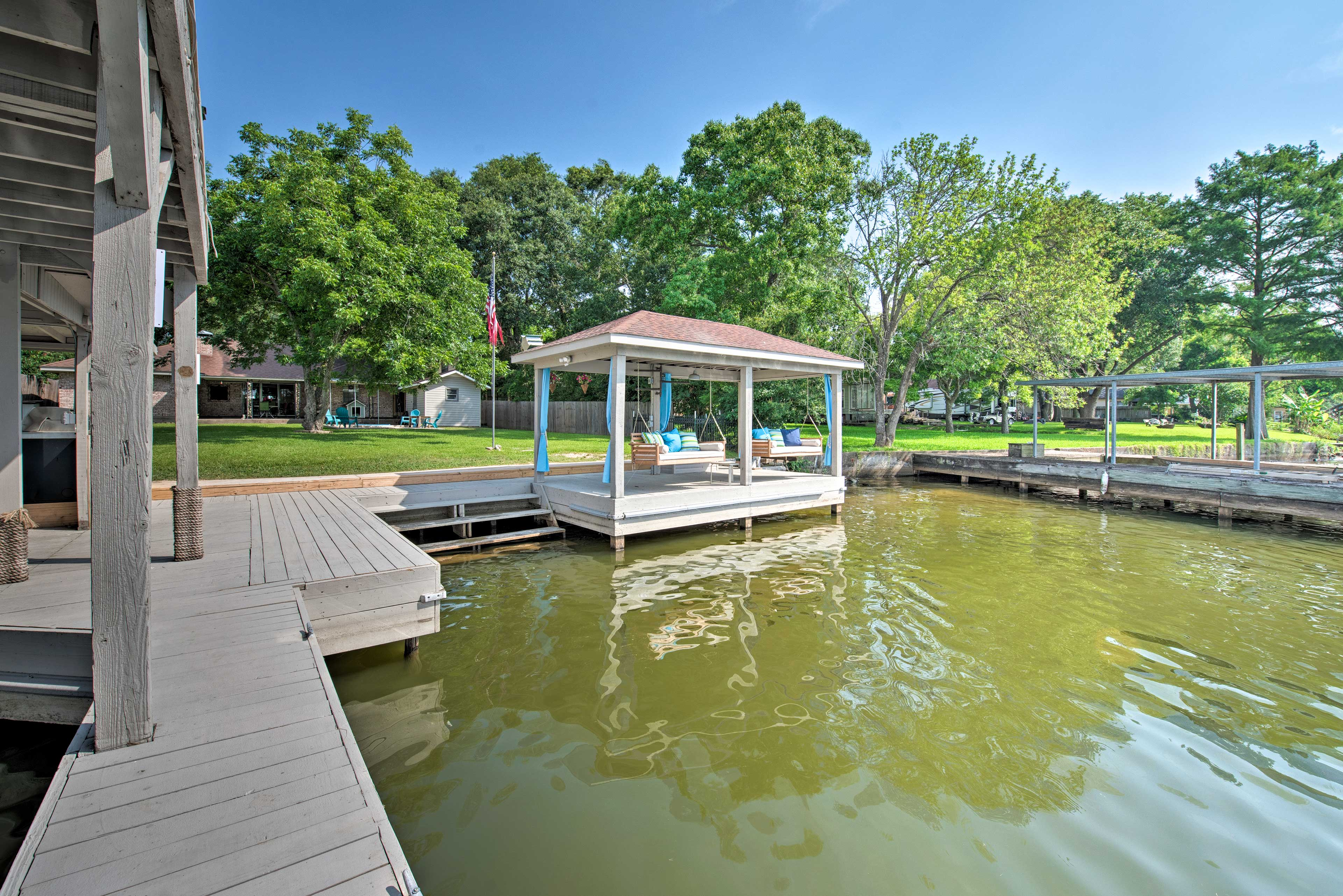 Swing your worries away at this lakefront property.
