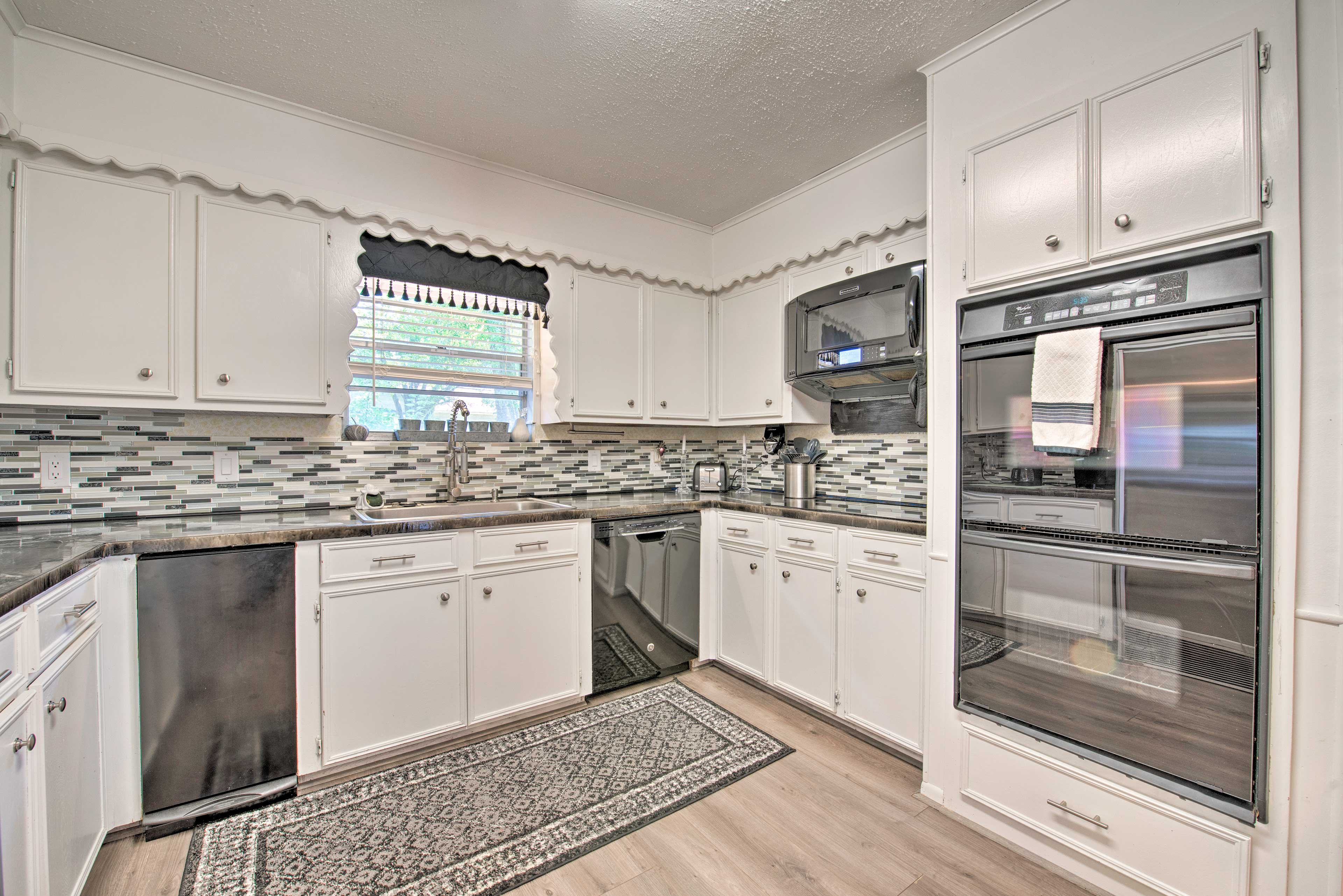 The fully equipped kitchen makes meal preparation a breeze.