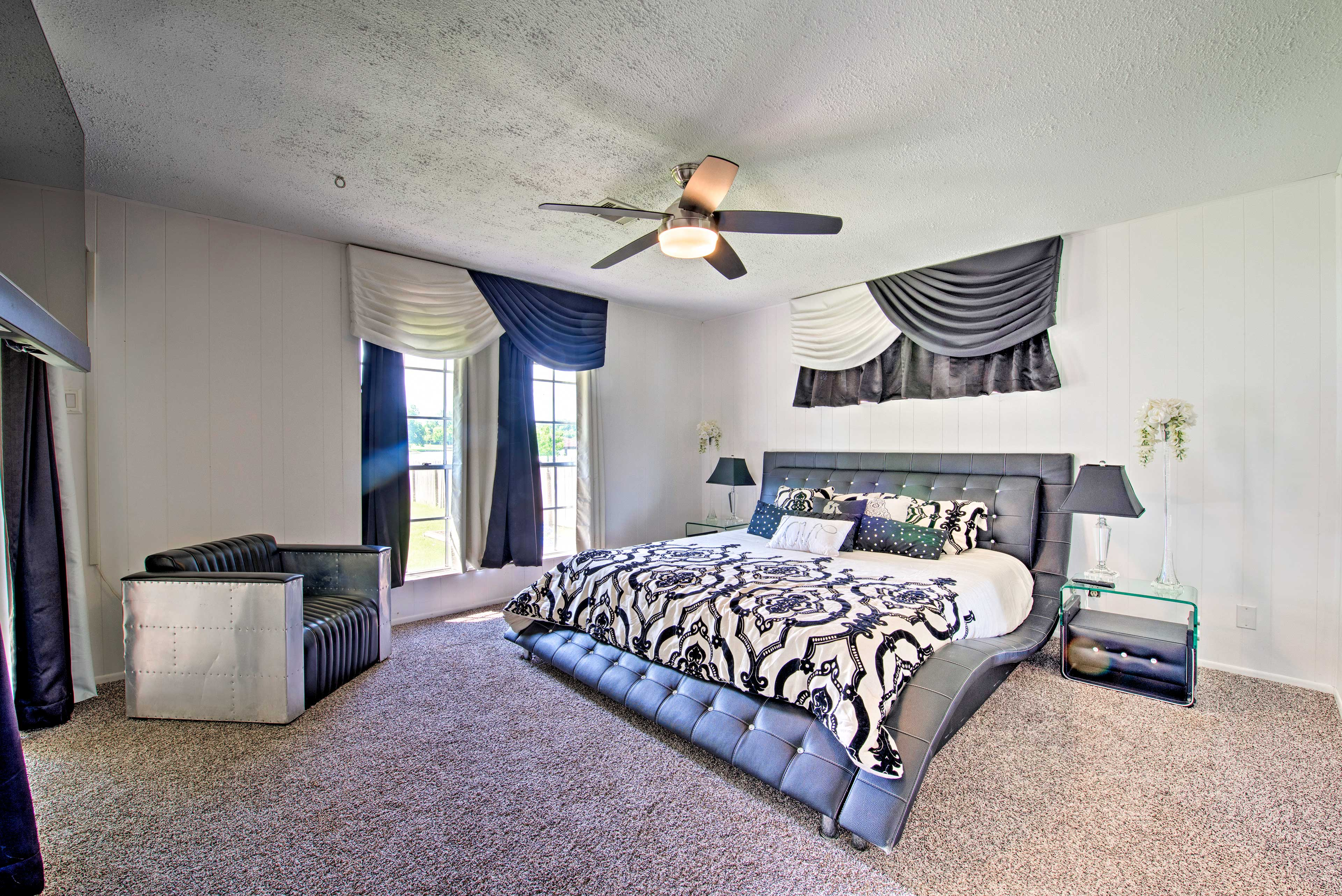 Find a king-sized bed in this bedroom.