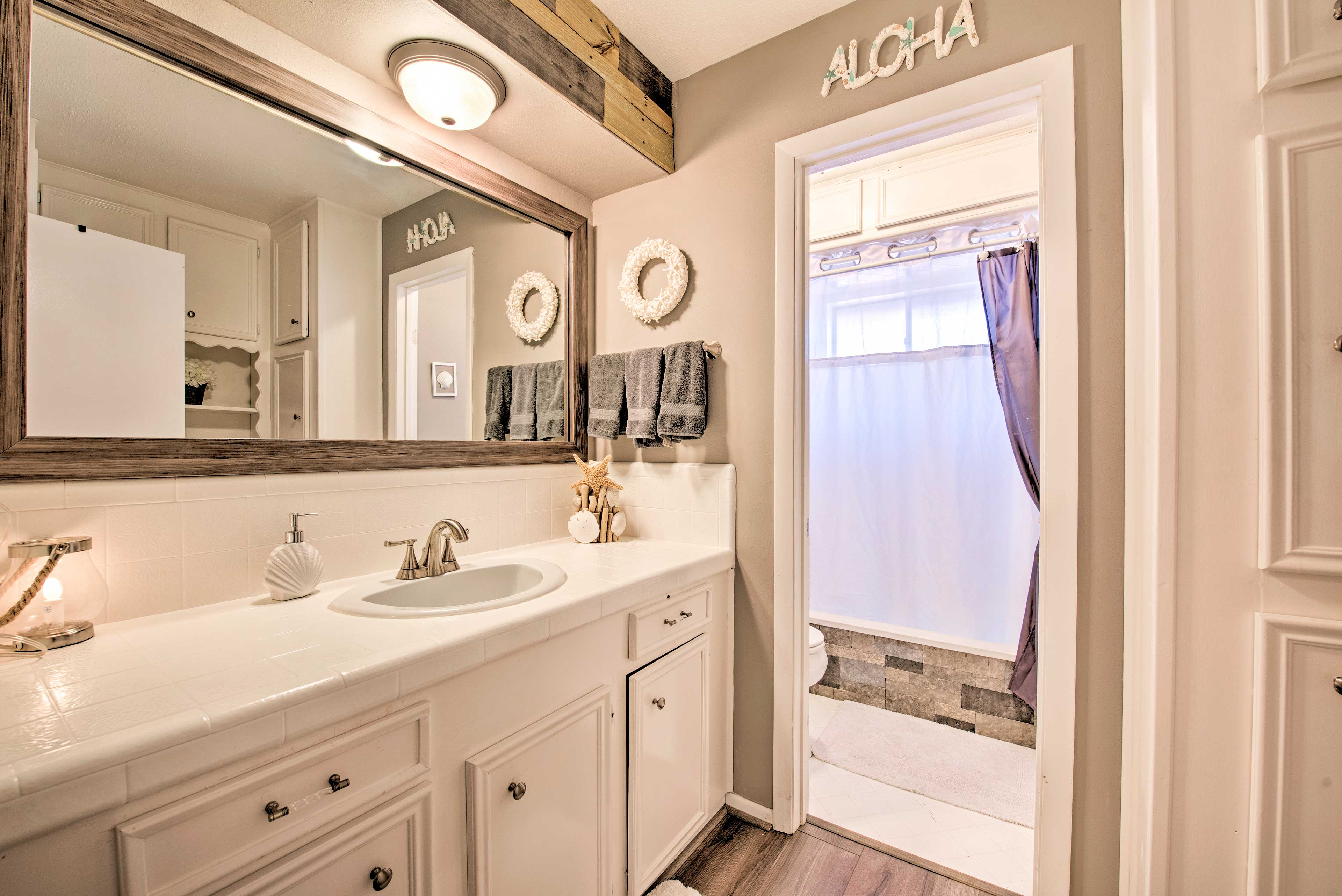 With the separated bathroom and vanity, everyone is able to get ready at once!