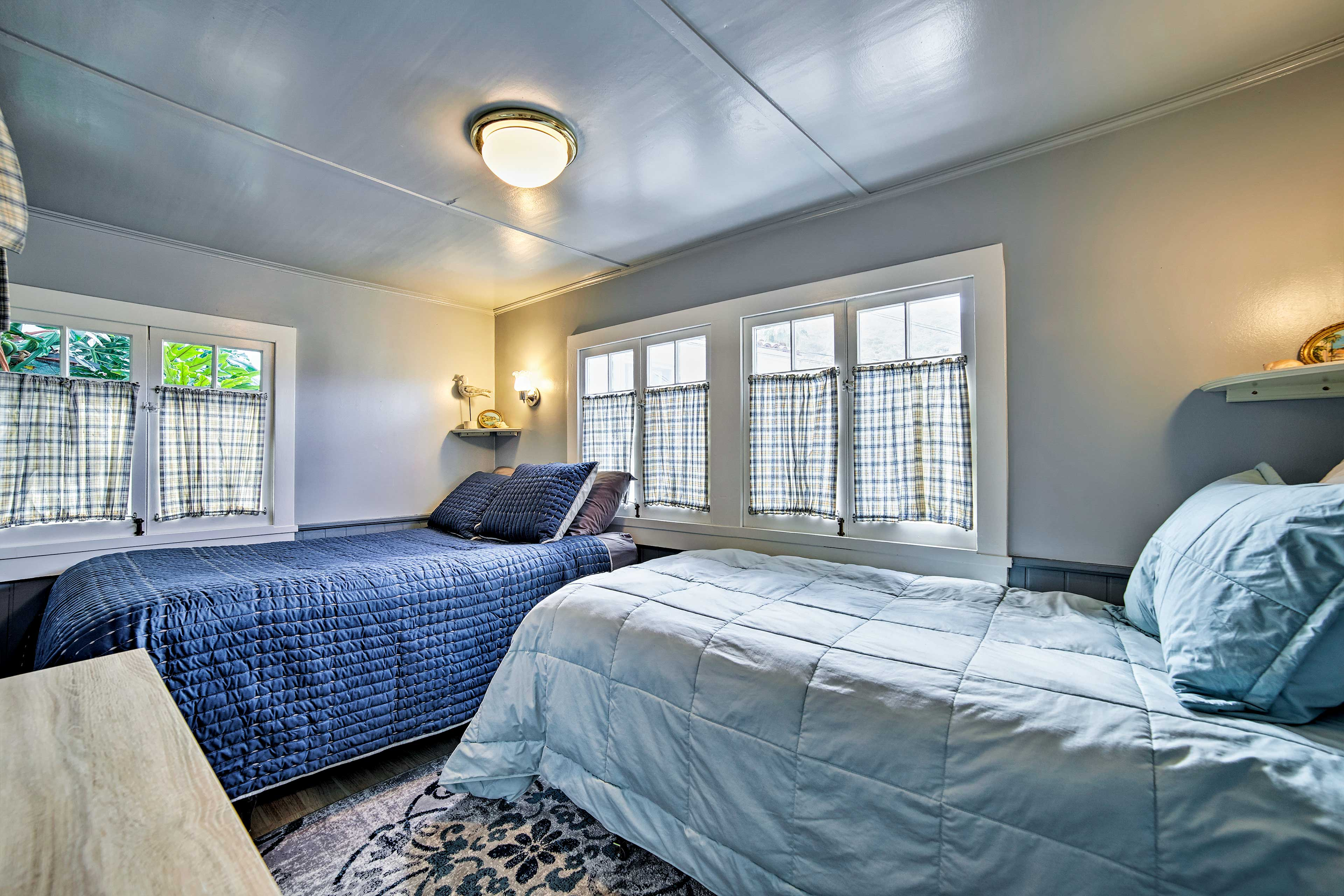 Find a full and twin-sized bed in this room.