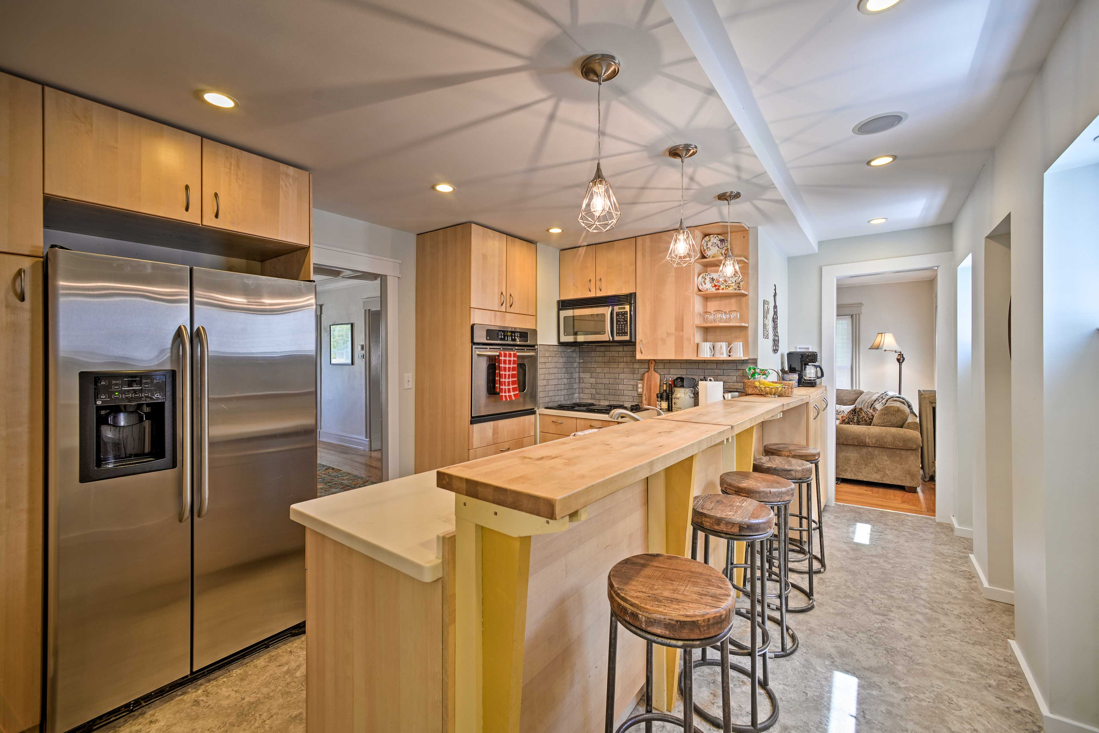 The kitchen is fully equipped with stainless steel appliances & cooking basics!