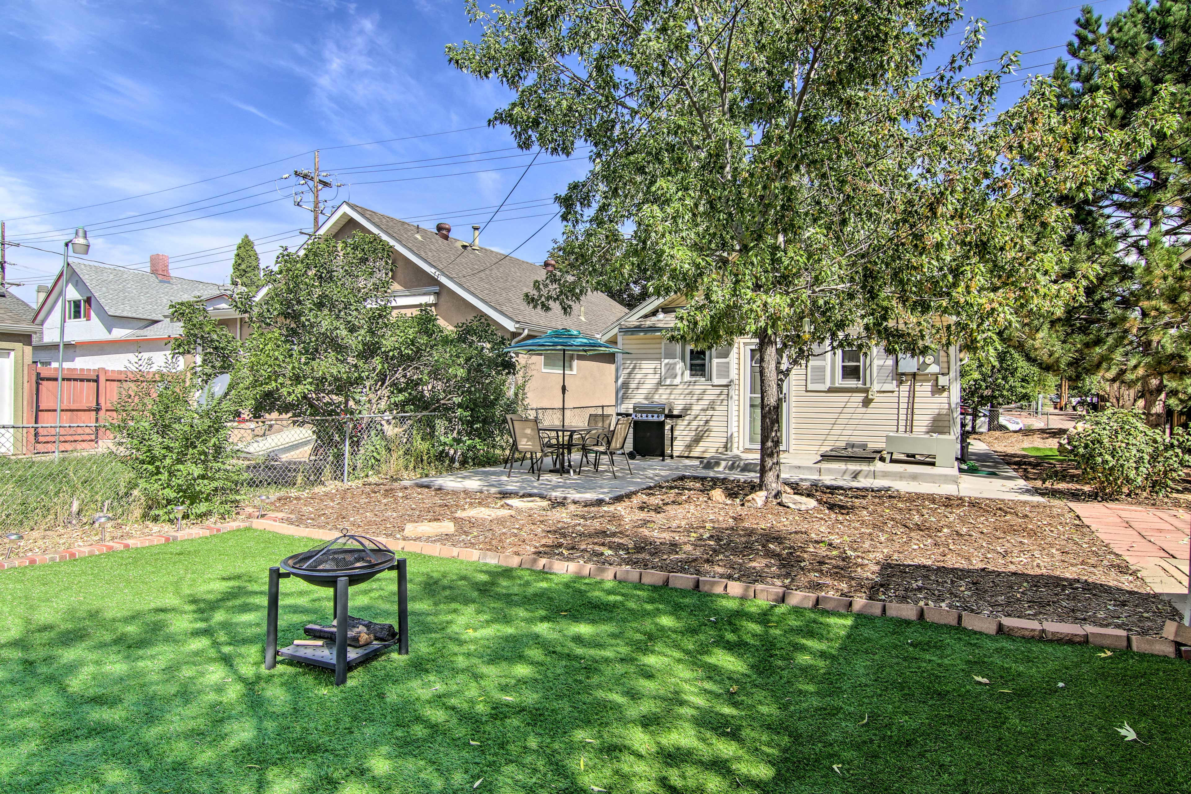 This home boasts a fire pit, gas grill, patio, and more.