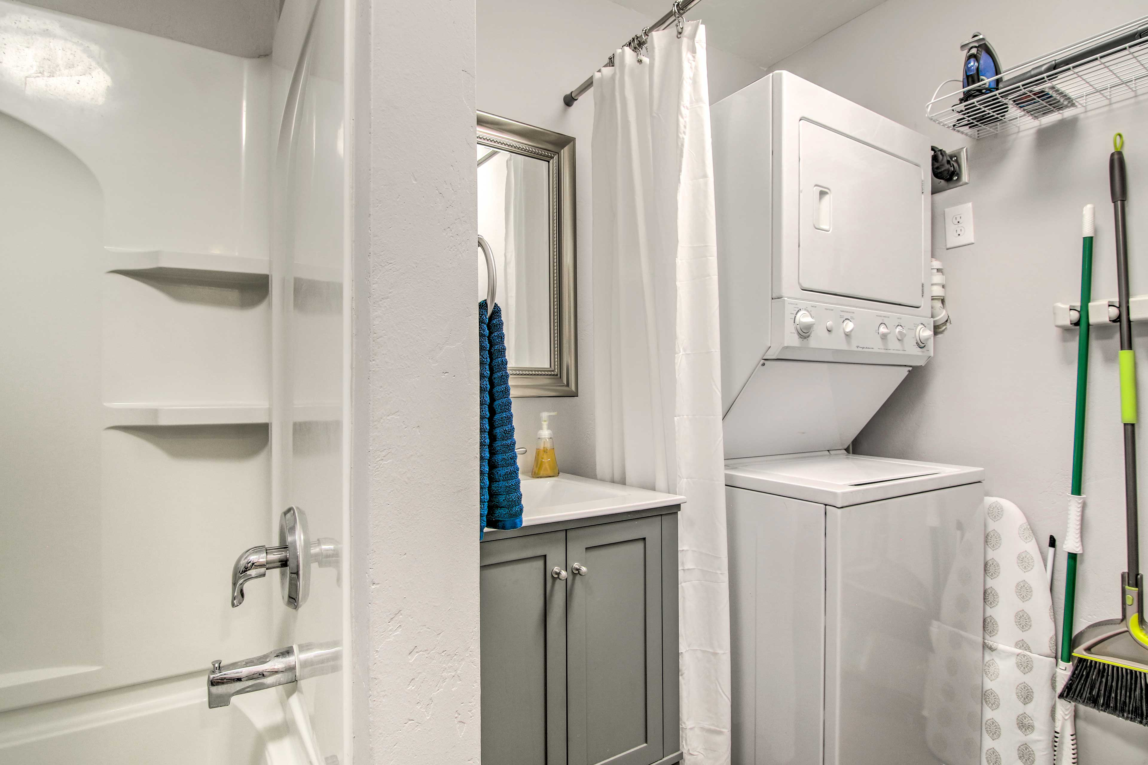 The full bathroom is also equipped with laundry machines.