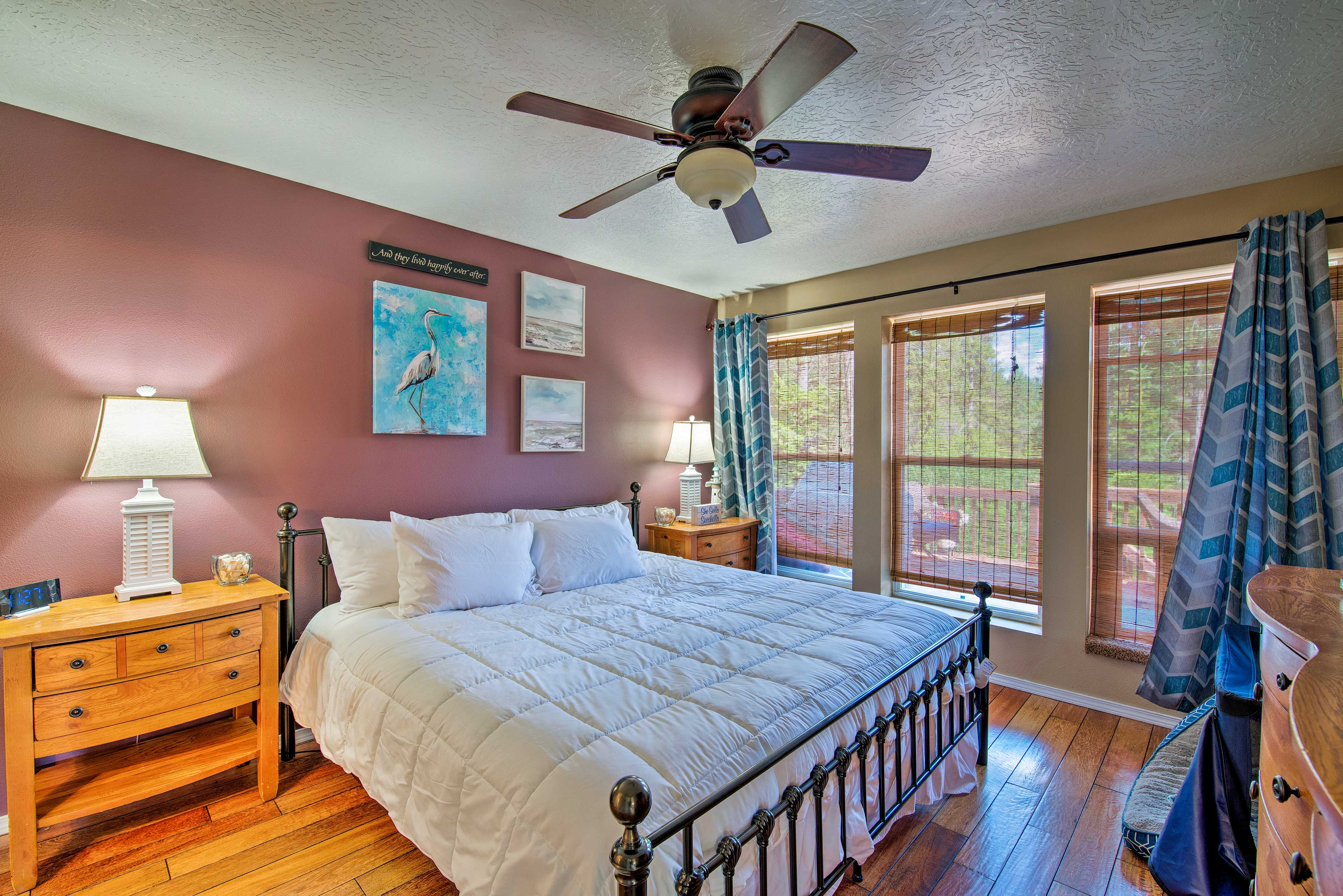 The master bedroom boasts a California King-sized bed.