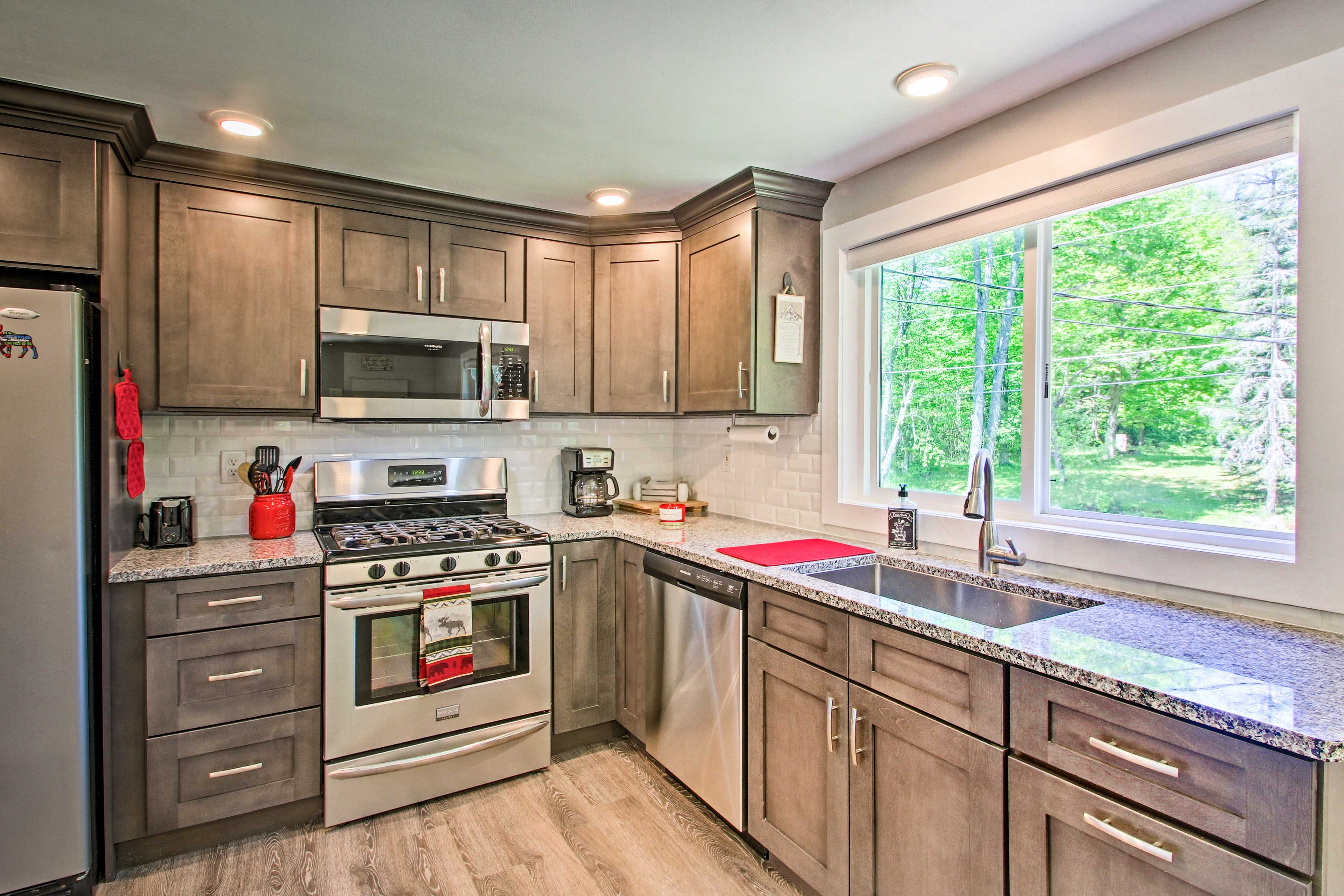 Stainless steel appliances elevate the kitchen.