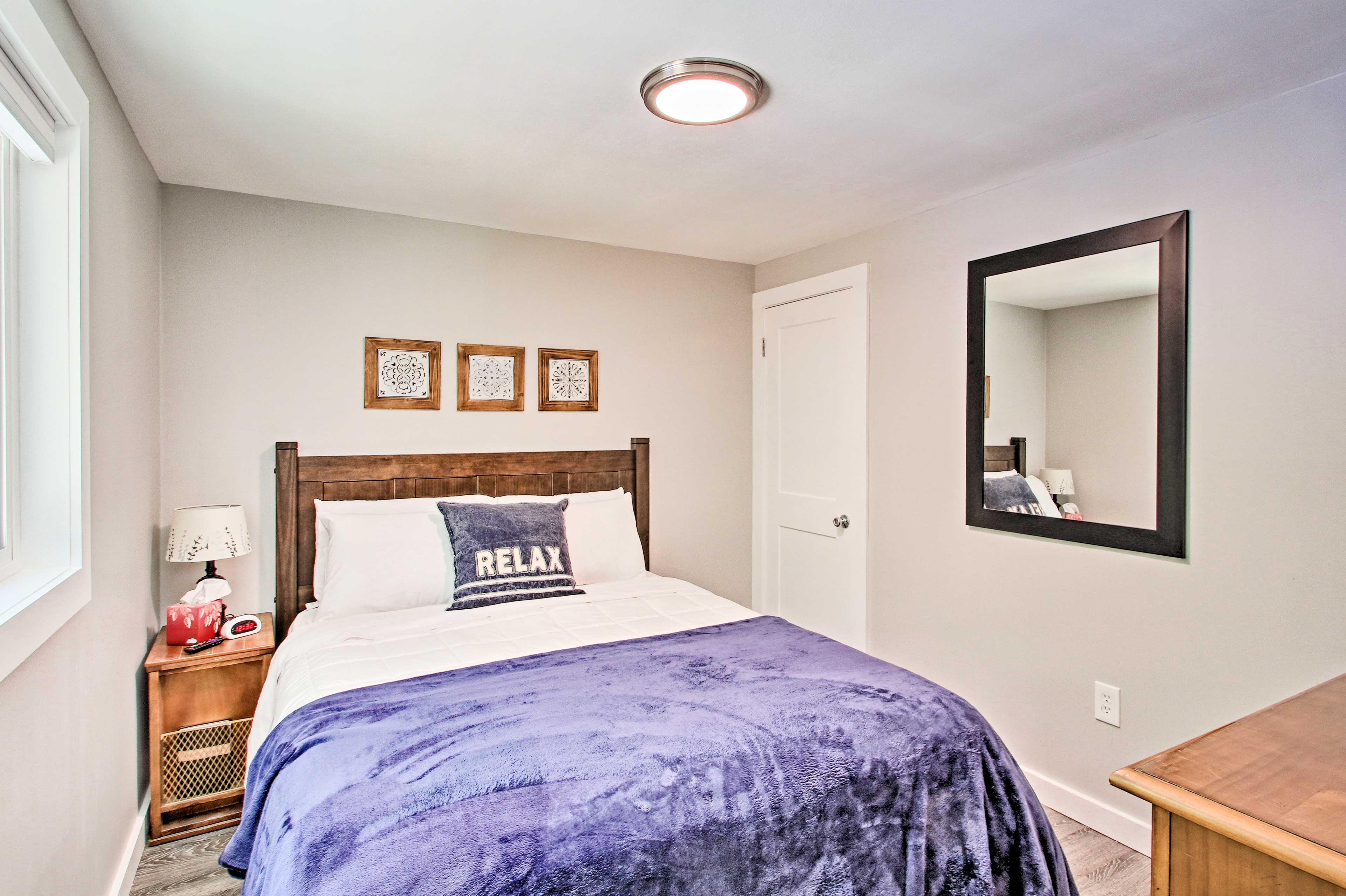 Two travelers can claim the home's lovely first bedroom.
