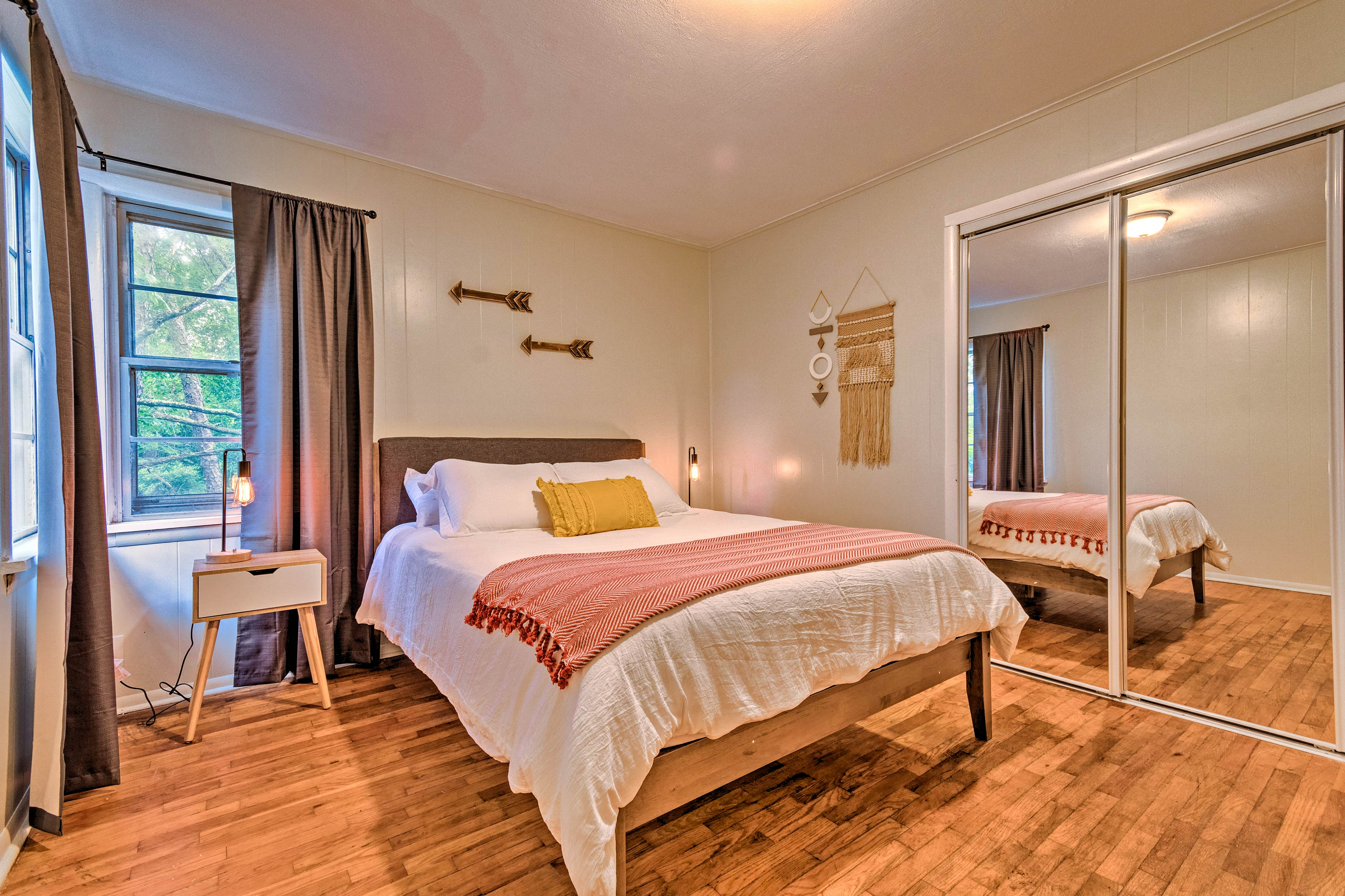 The master bedroom features a queen-sized bed for 2.
