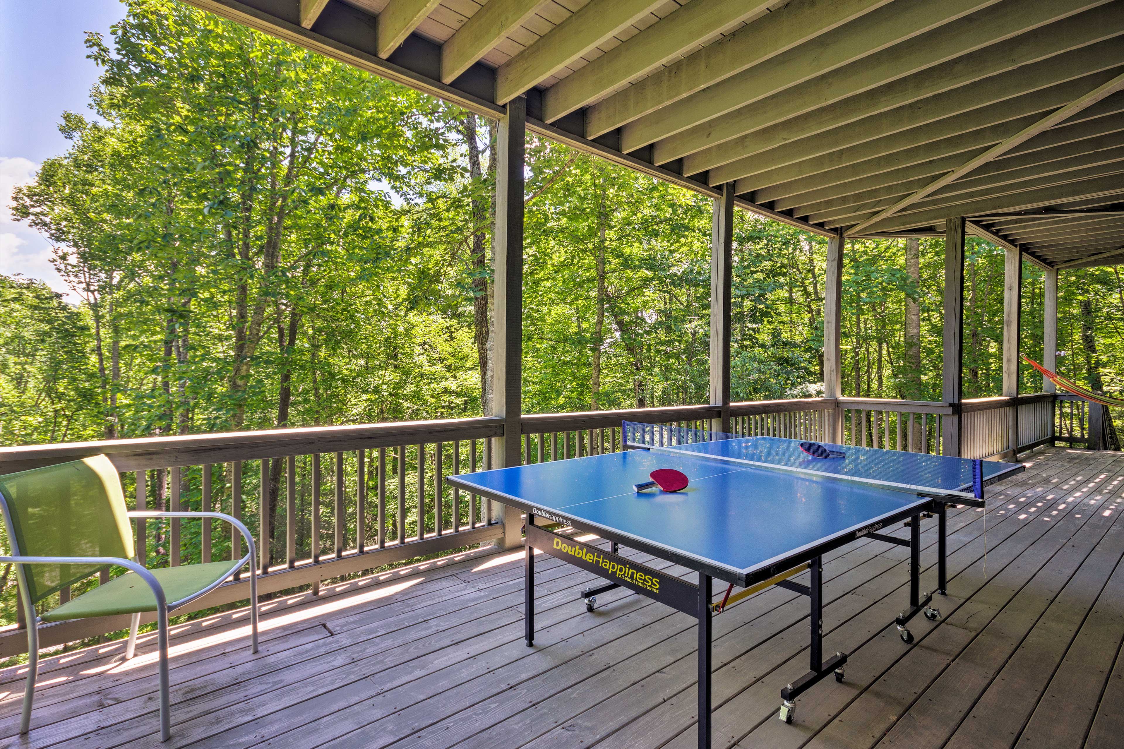 The lower level deck has a ping pong table.