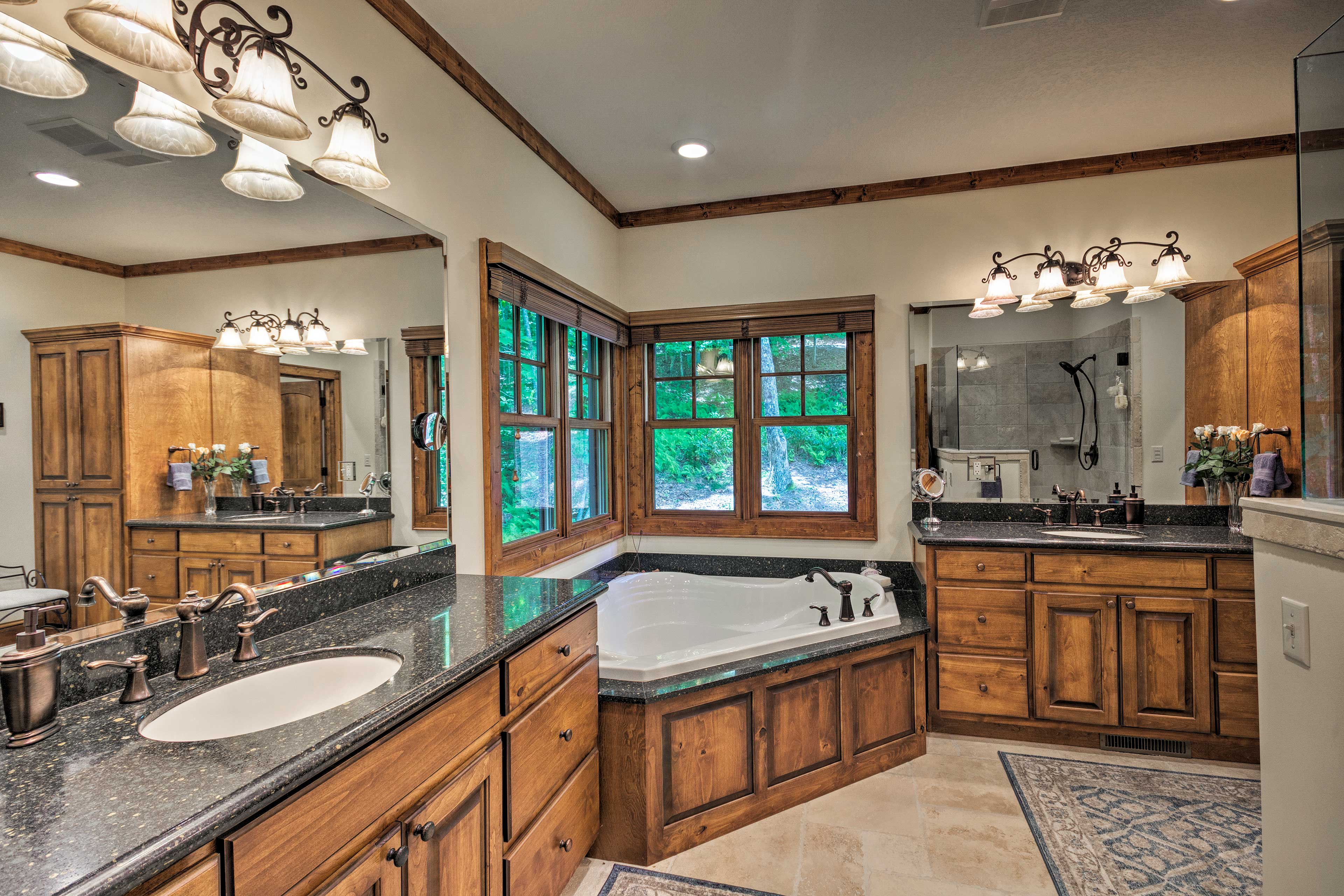 The en-suite bathroom boasts a walk-in shower and large soaking tub.