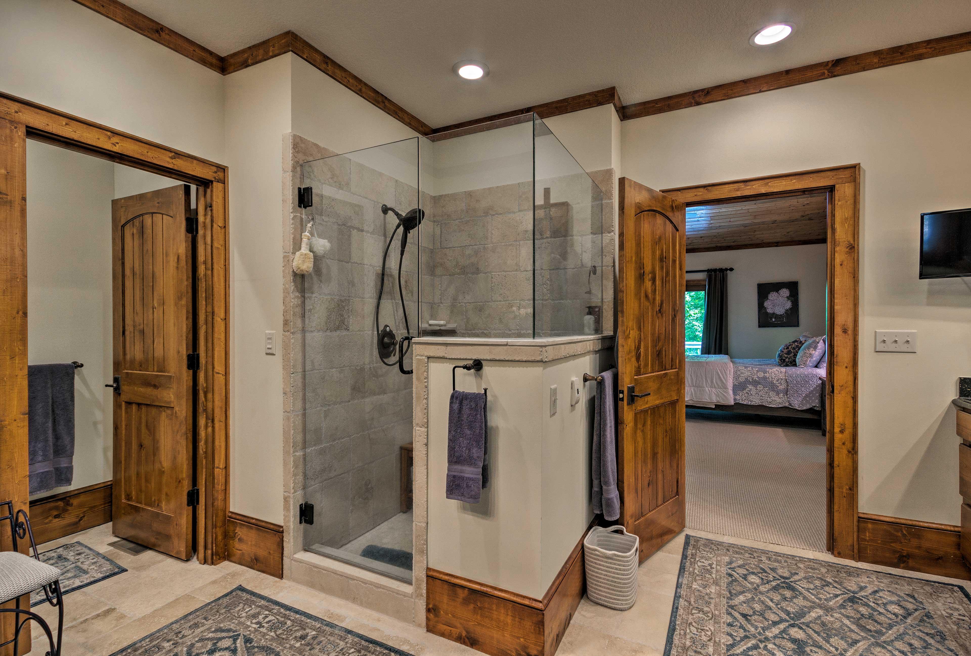 The bathroom has heated floors and a flat-screen Smart TV.