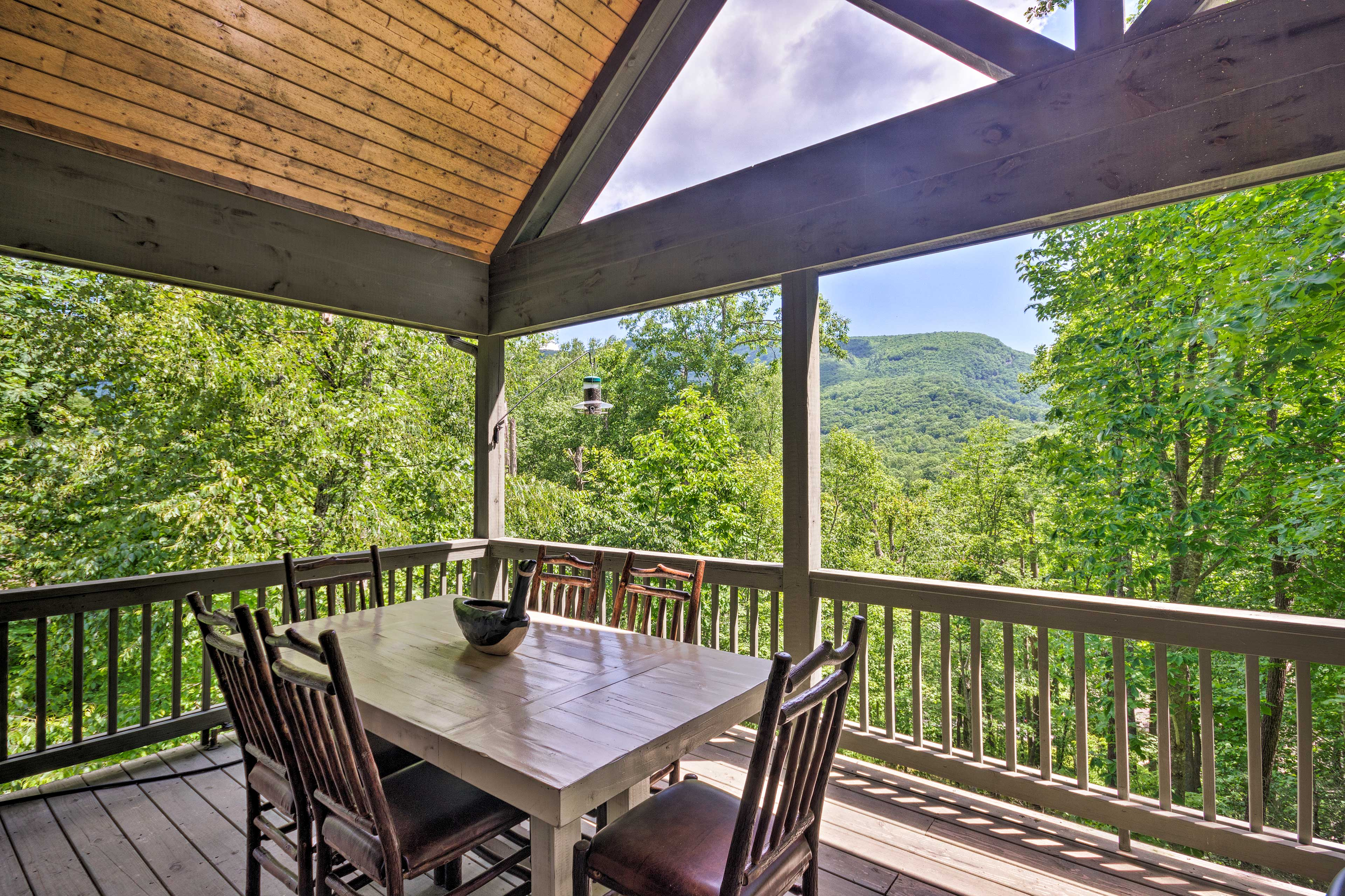 This vacation rental home features beautiful mountain views from its deck!