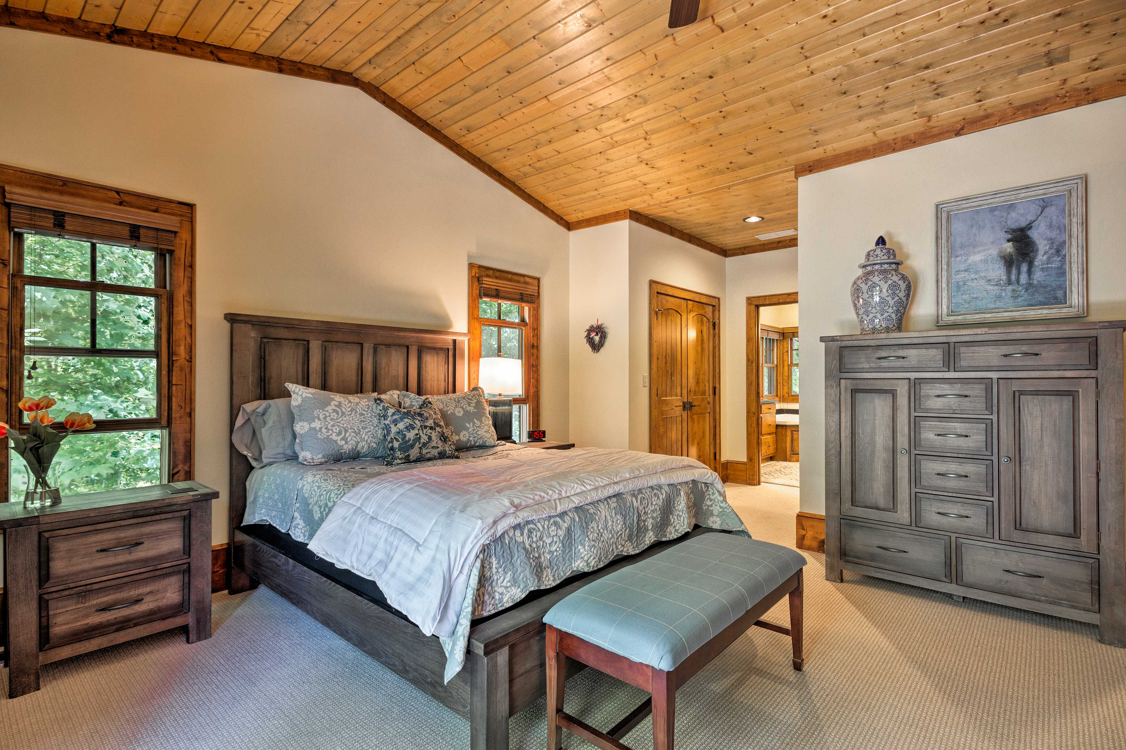This master bedroom includes a queen bed.