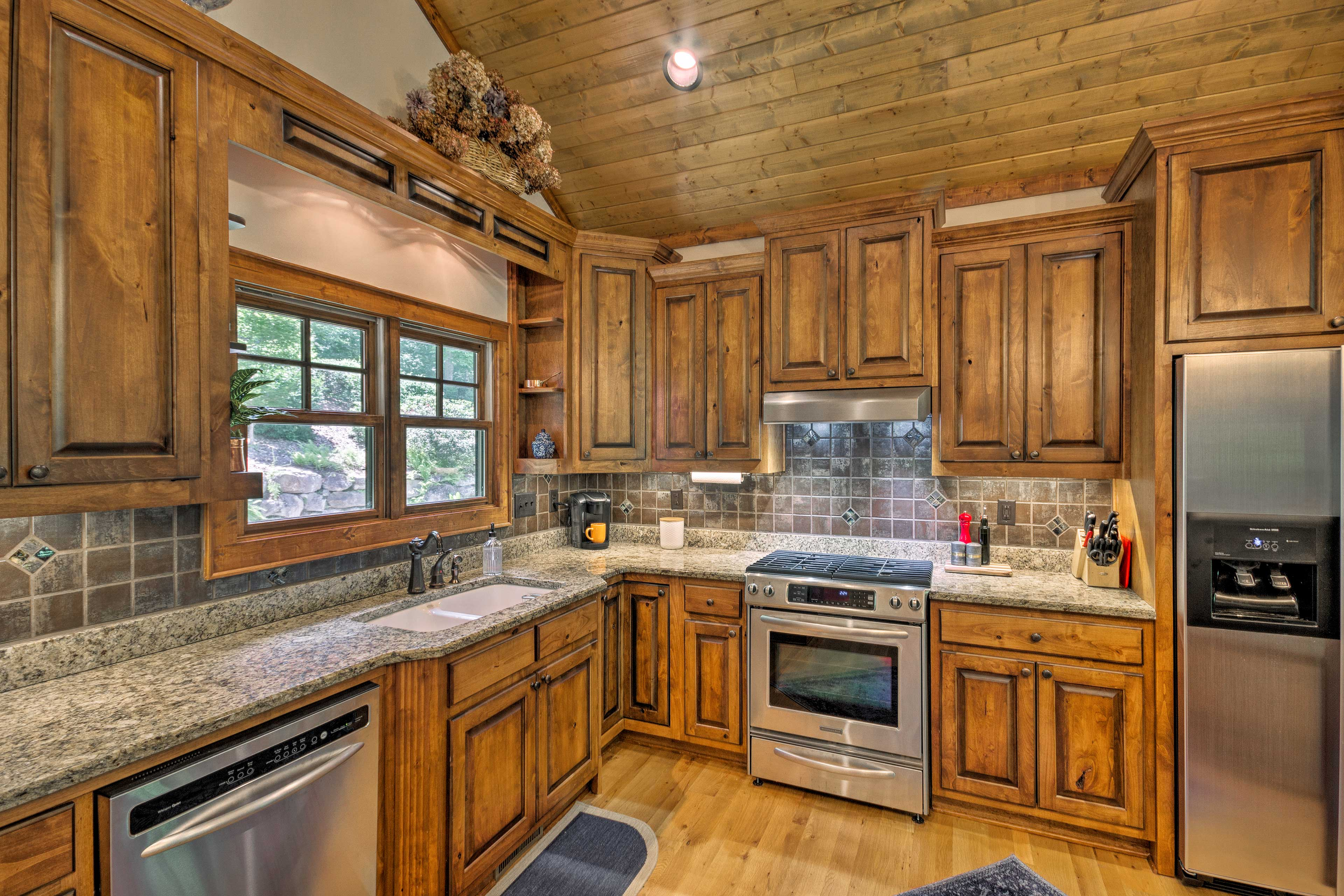 The kitchen has stainless steel appliances and a Keurig coffee maker.