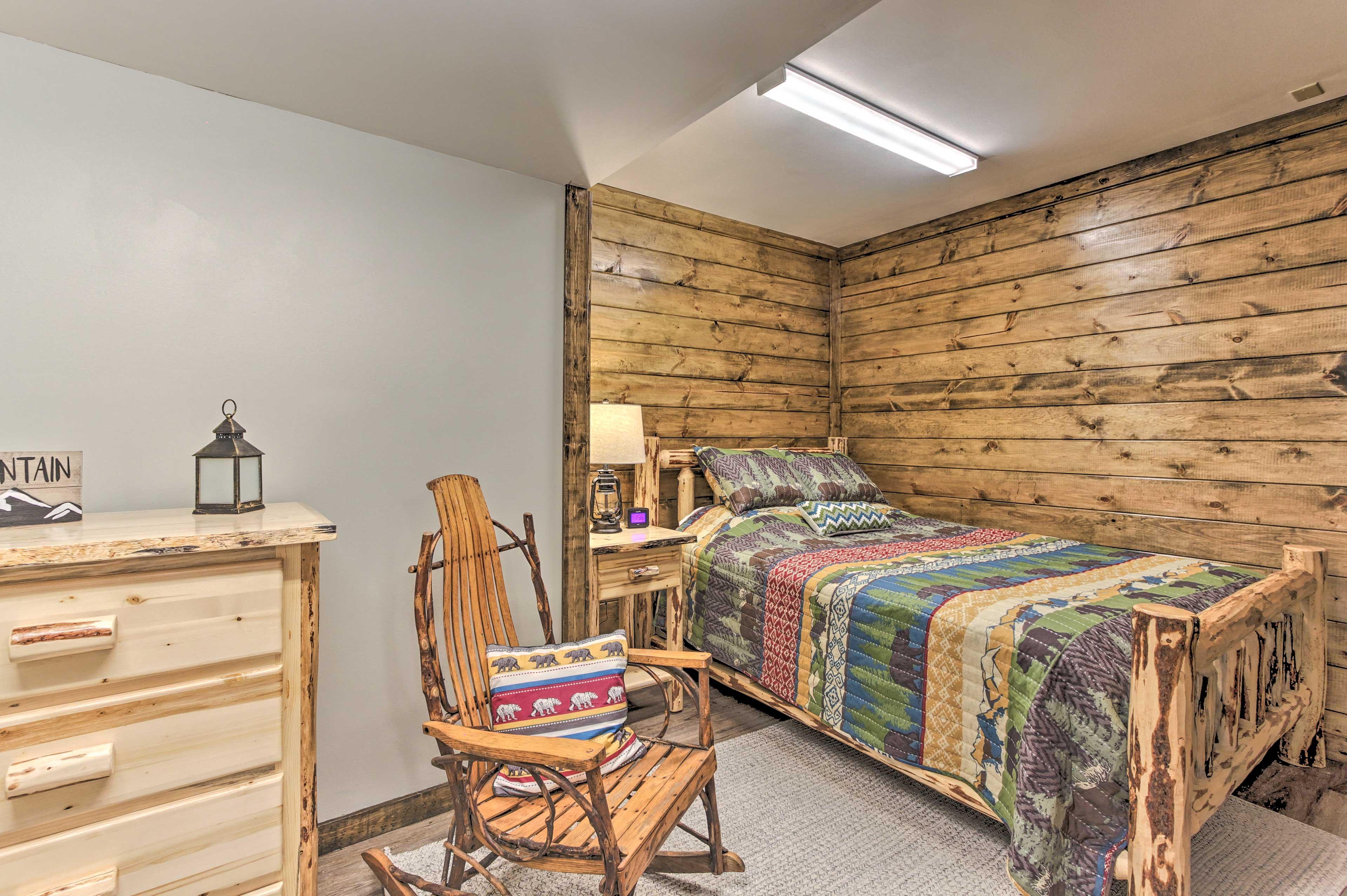 The last bedroom features a queen bed.