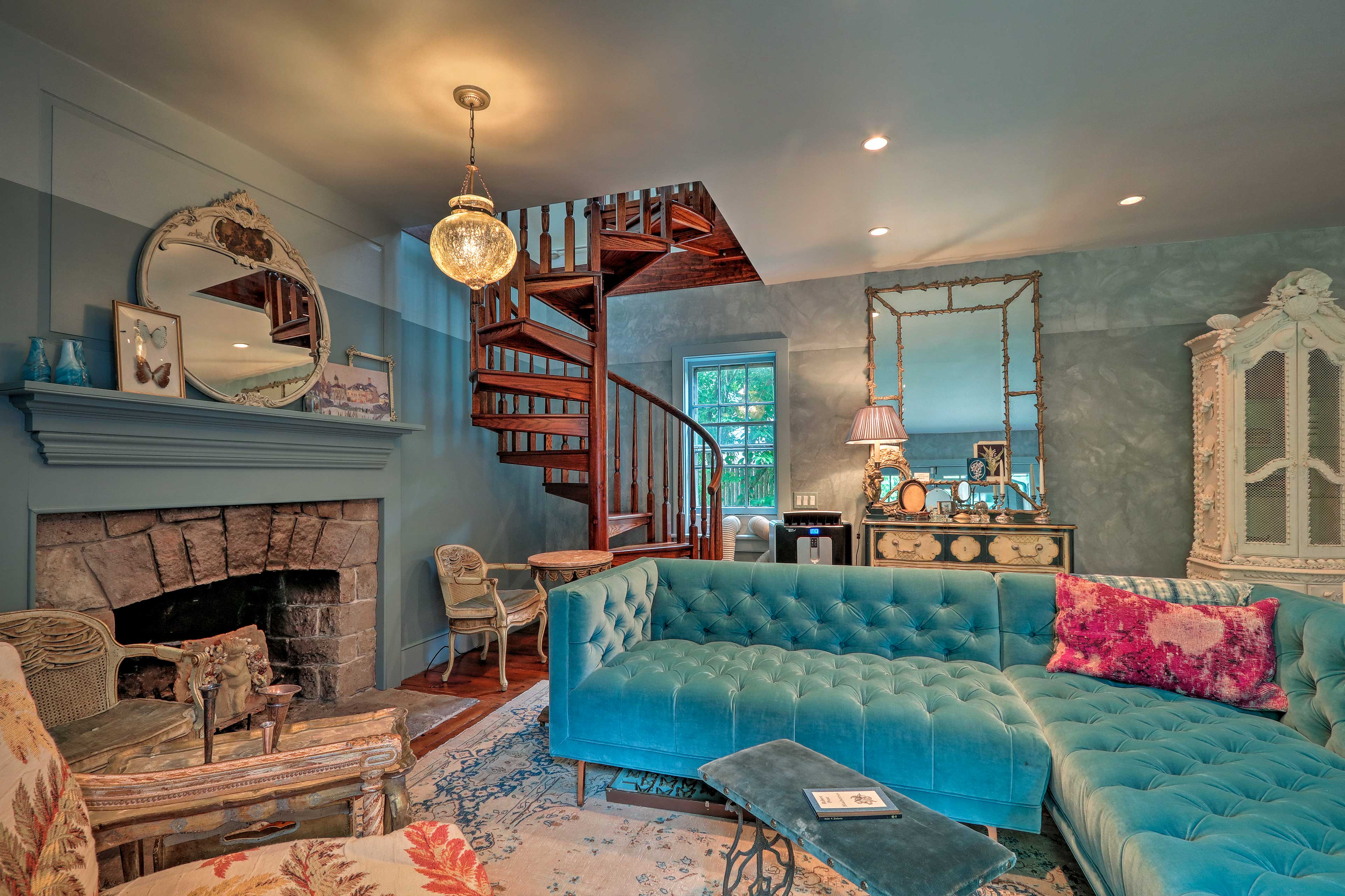 A spiral staircase highlights the living room.