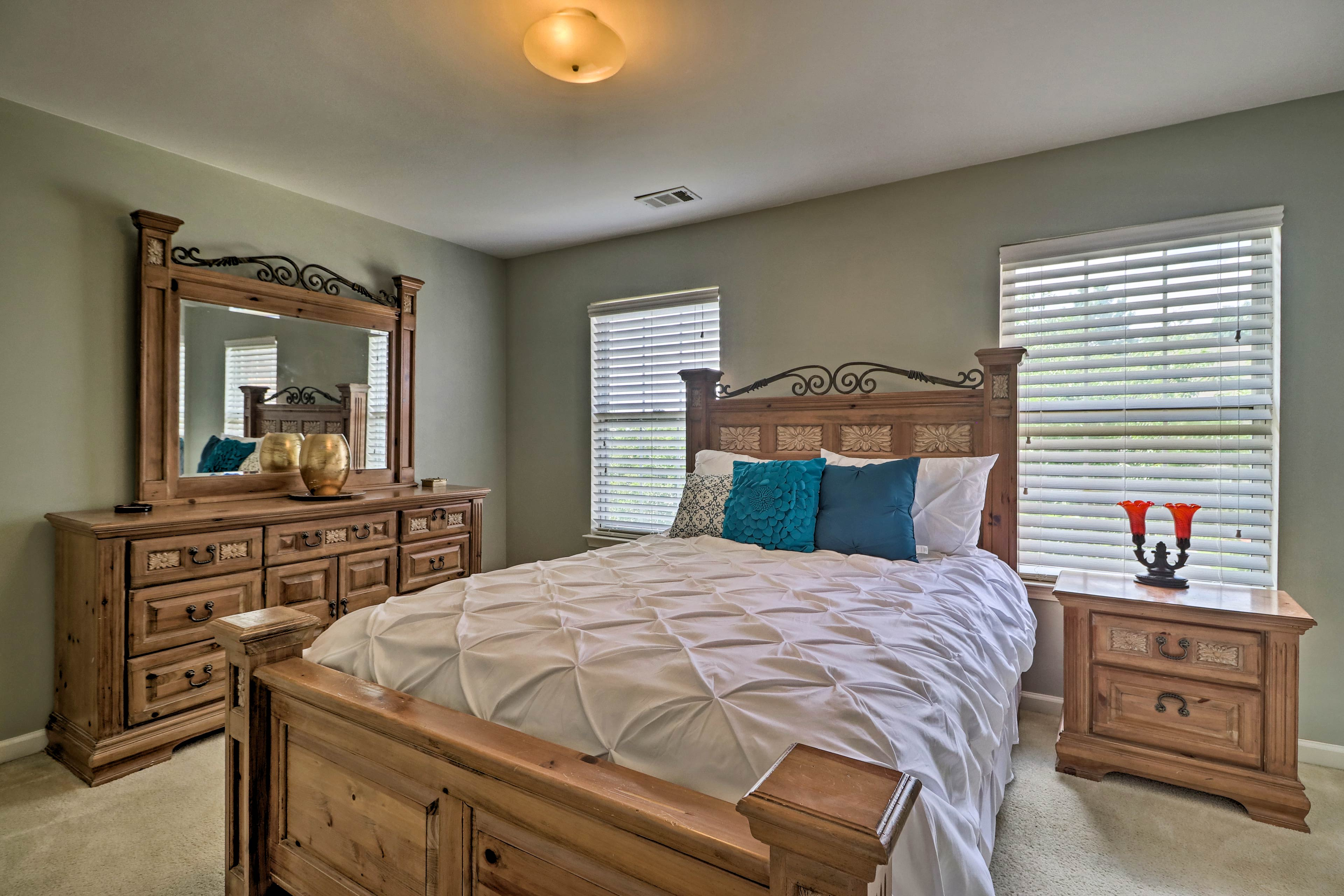 Catch up on your sleep in this queen bed.