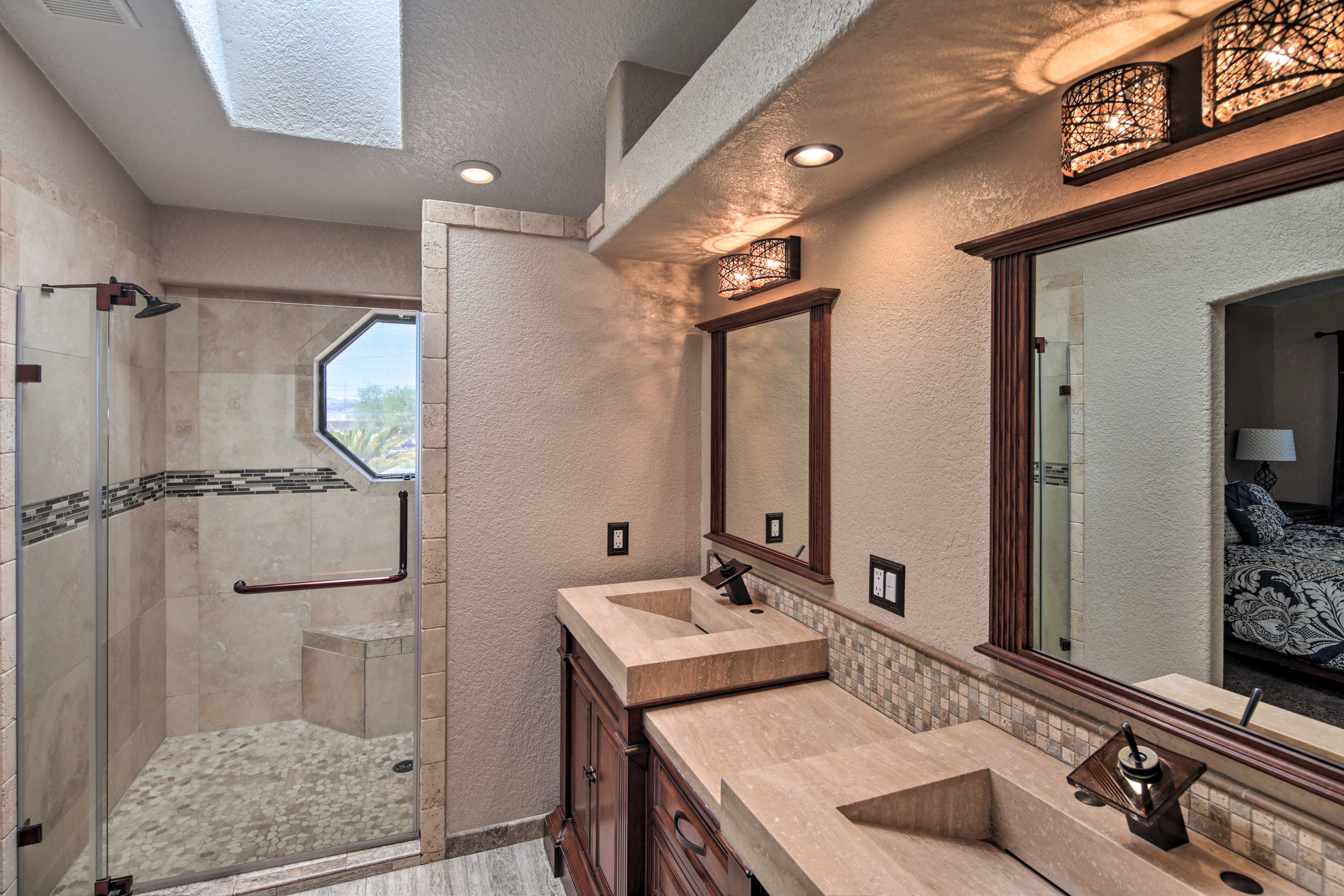 The upscale amenities continue in the en-suite bath!