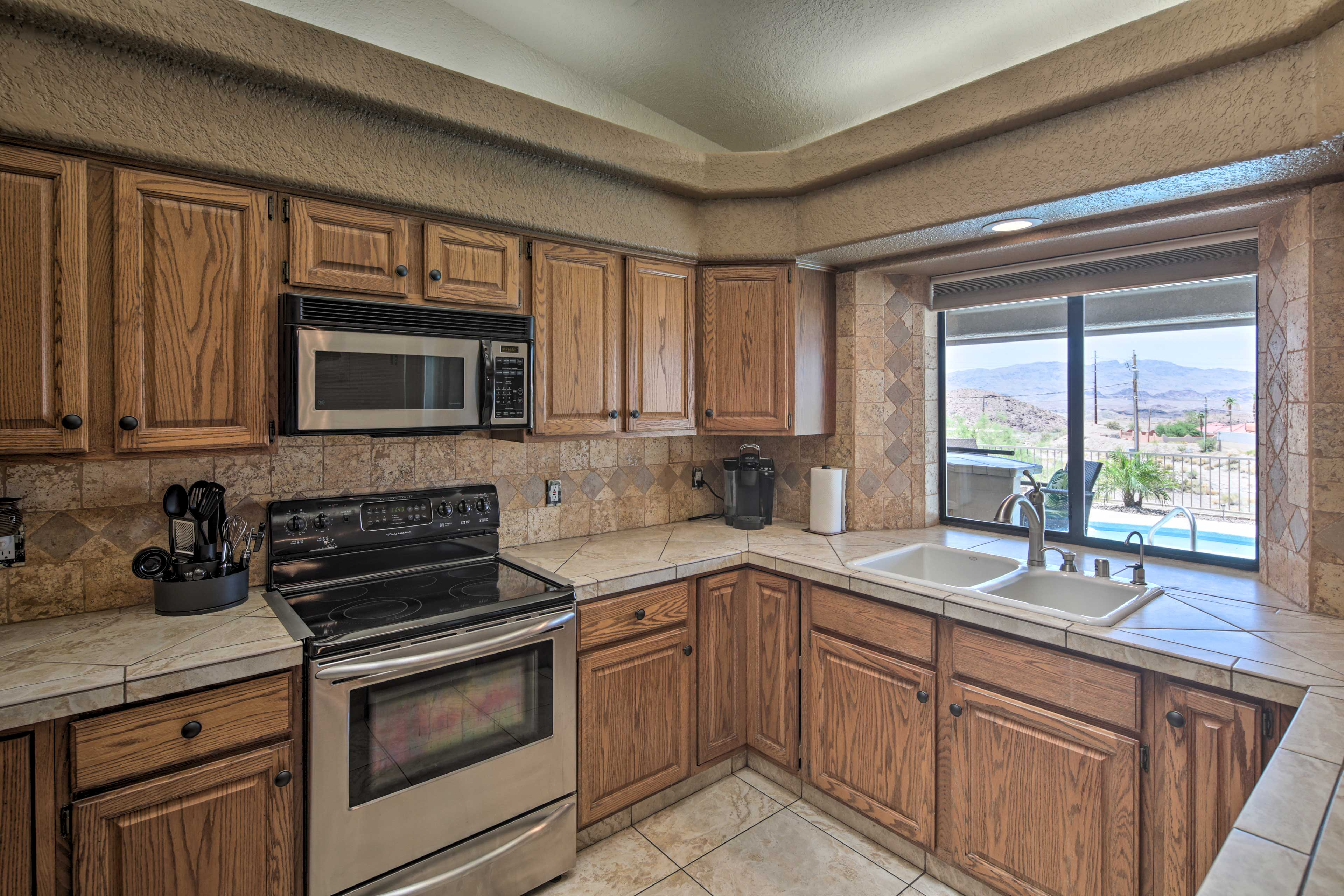 The kitchen is fully equipped, even boasting mountain views.