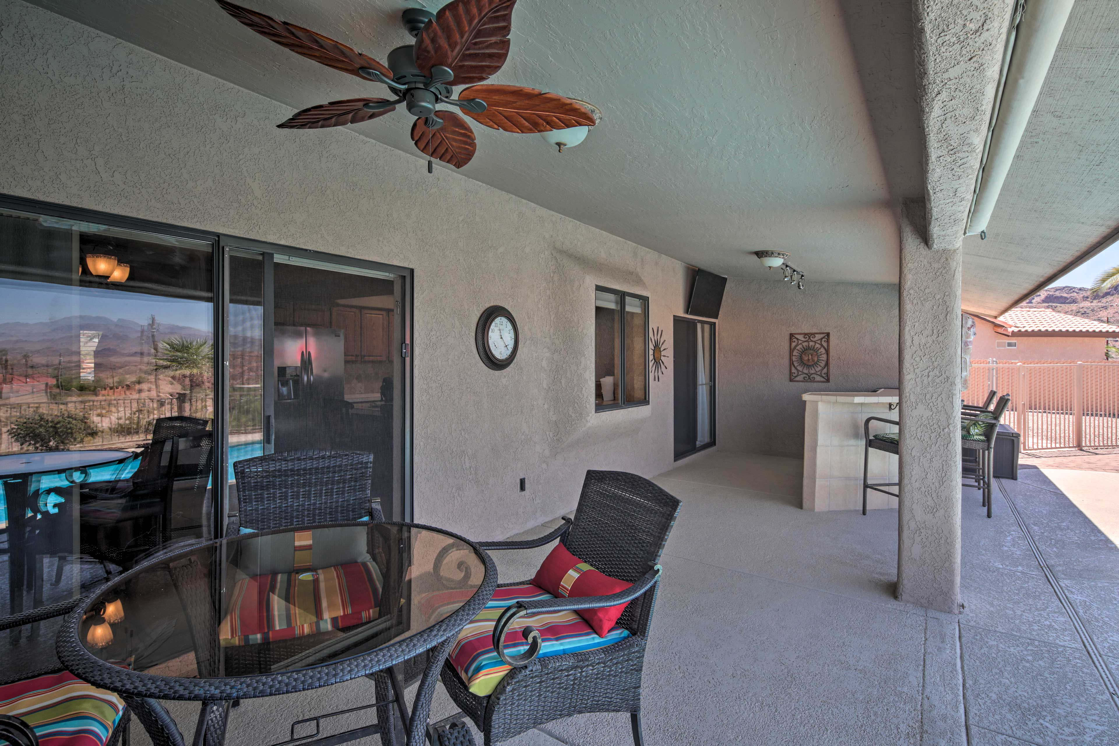 Outside, the covered patio space features seating and its own TV.