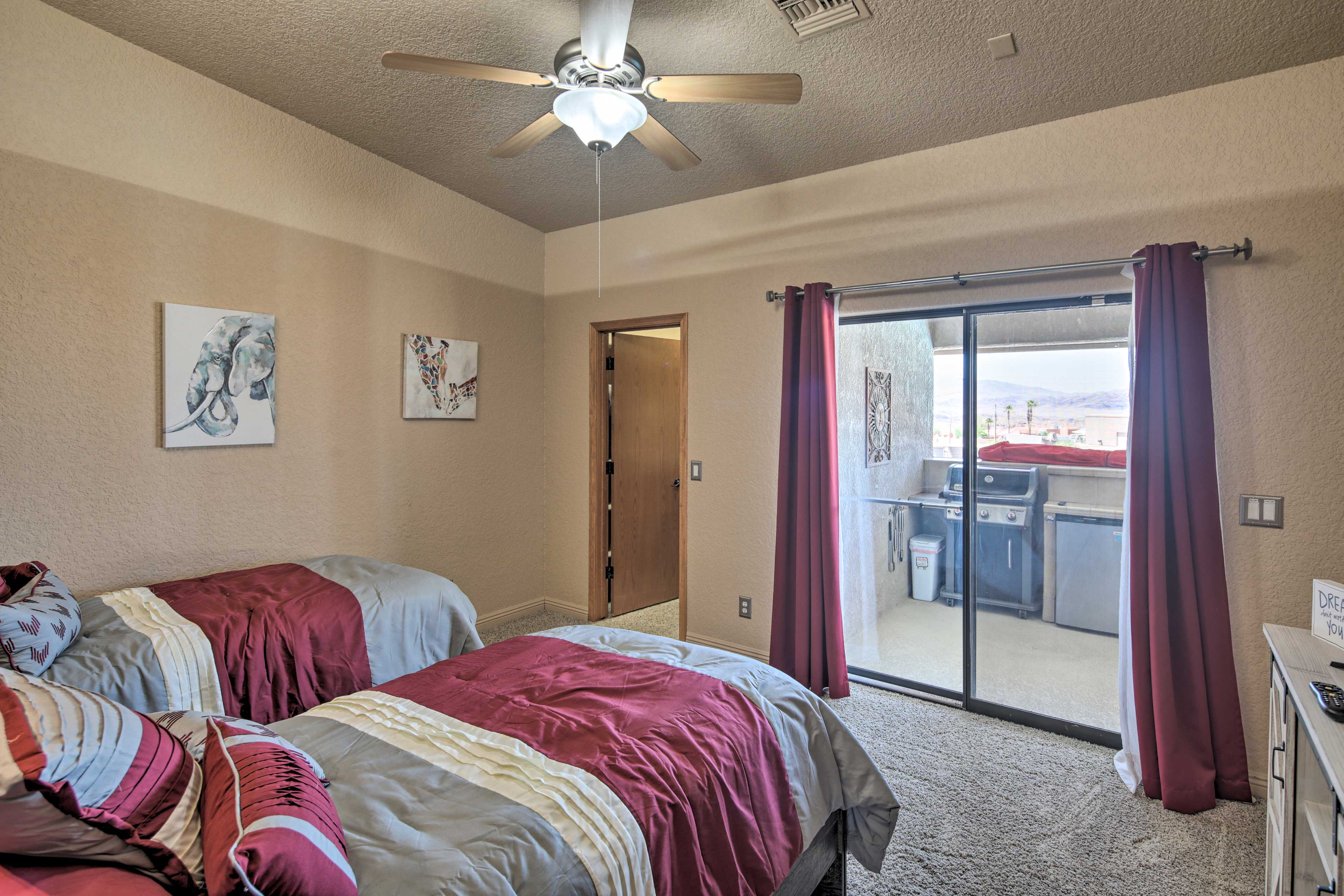 Patio access and a flat-screen TV complete the bedroom.