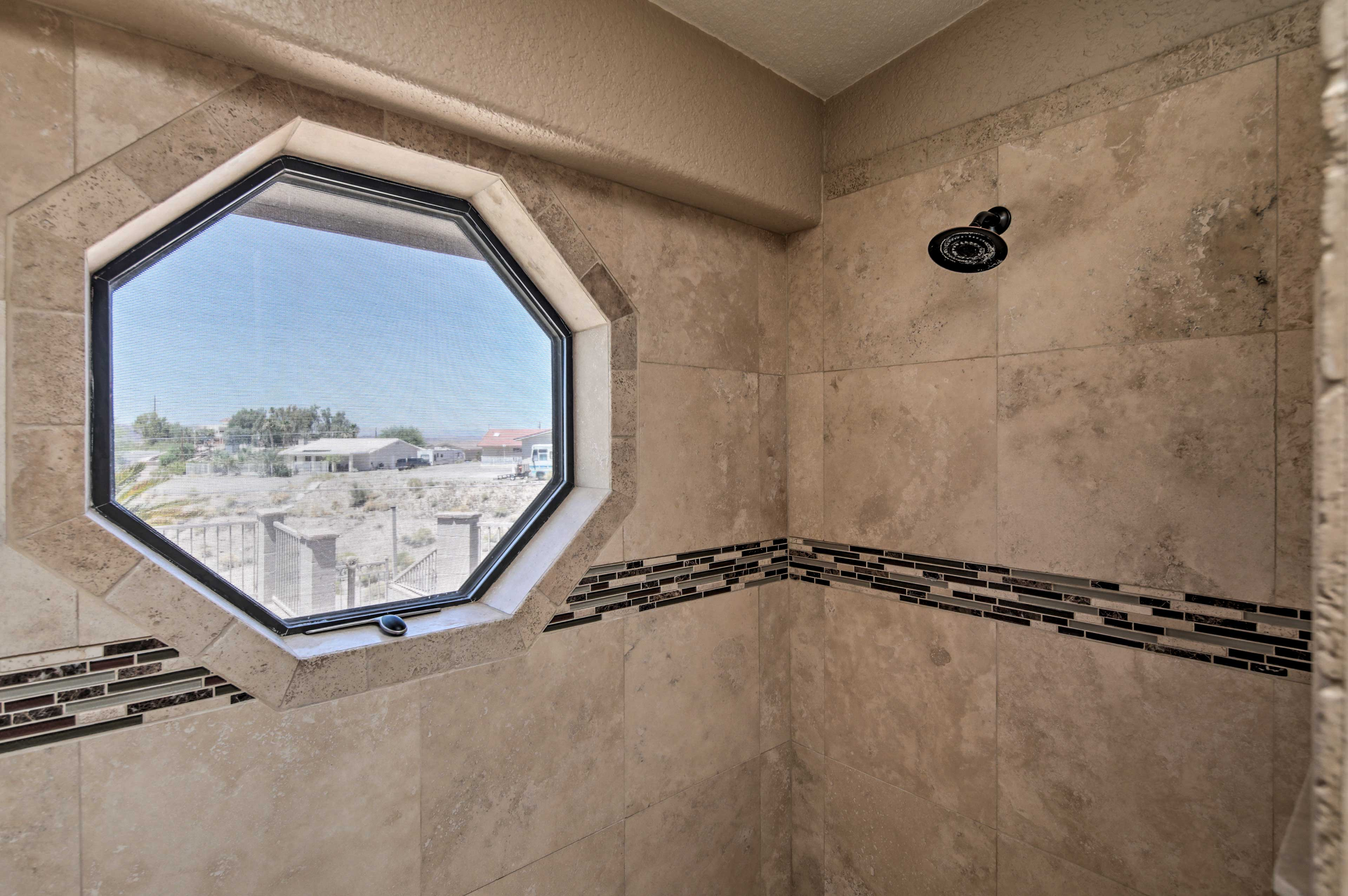 The walk-in shower has its own window!