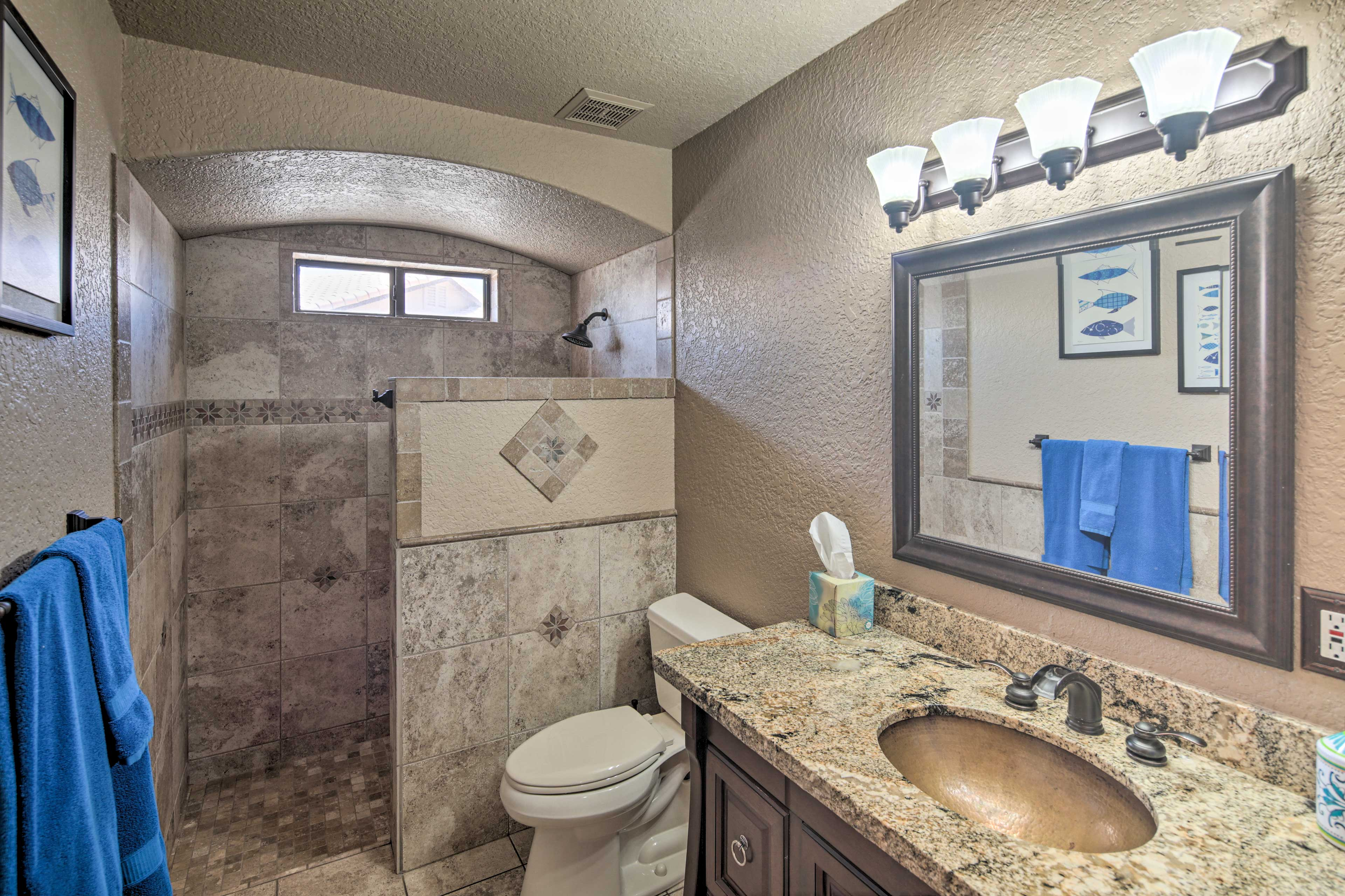The grand second bathroom also boasts a walk-in shower.