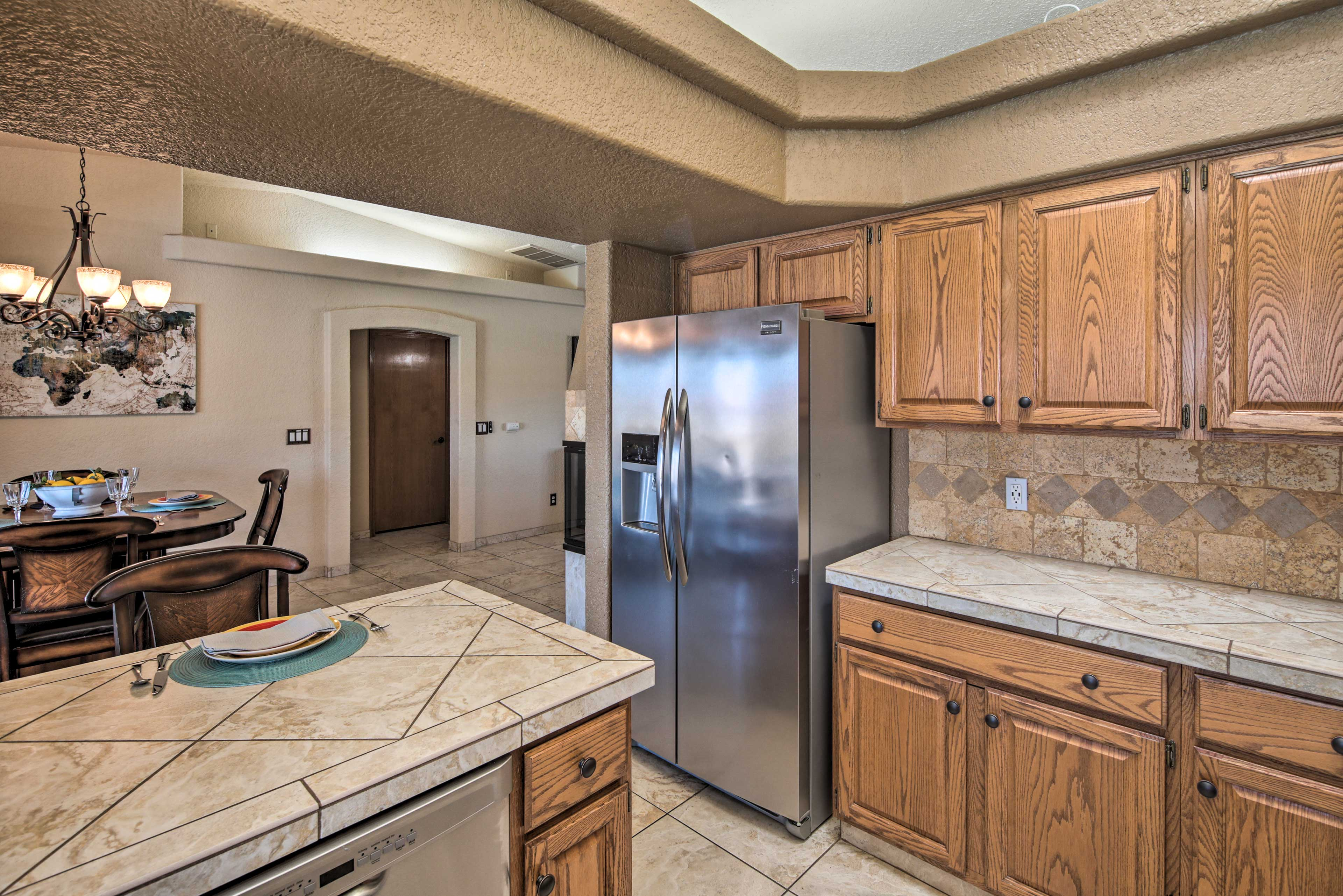 Stainless steel appliances elevate the cooking space.