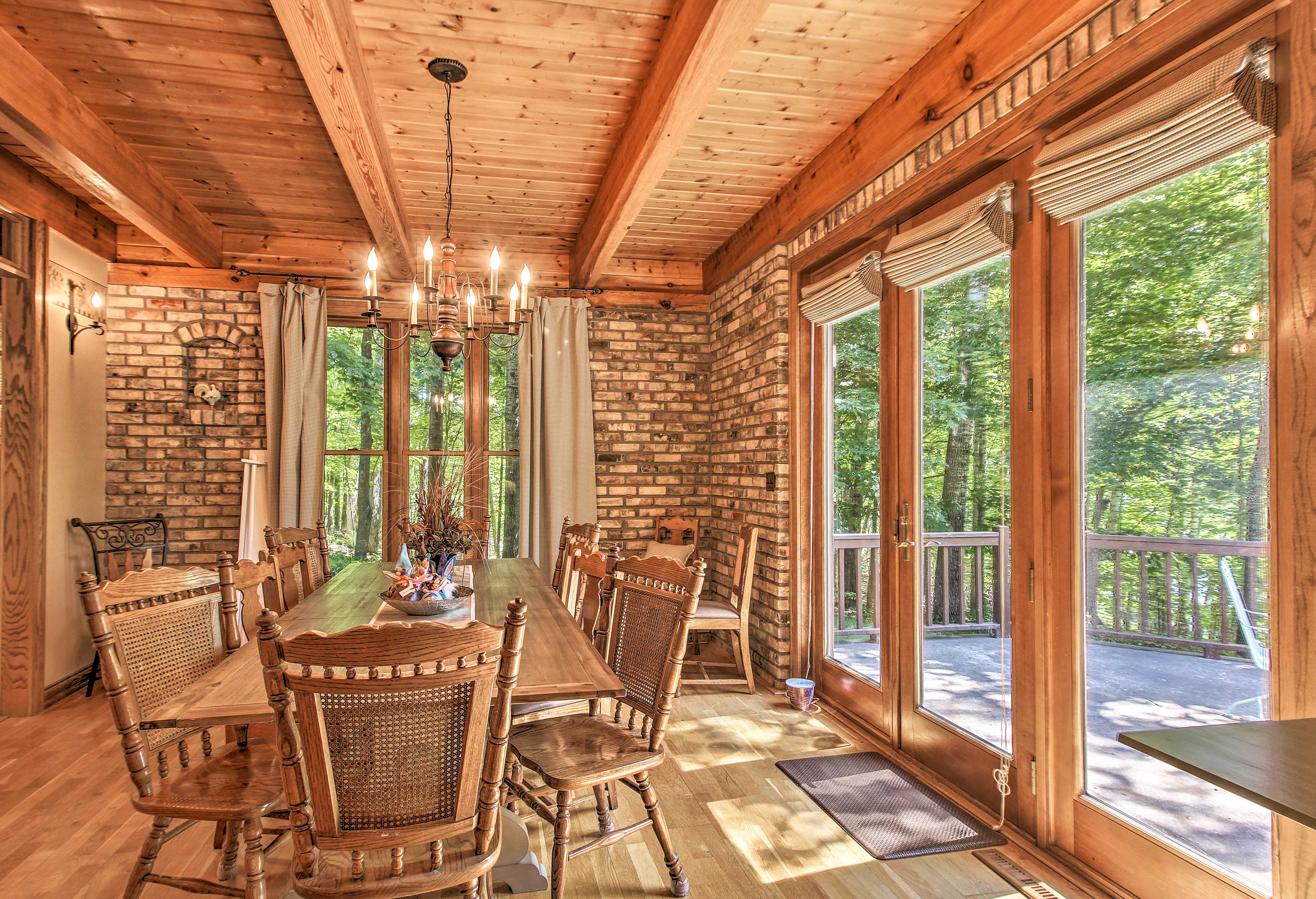 Elegant stone walls surround the dining room's 10-seat table.